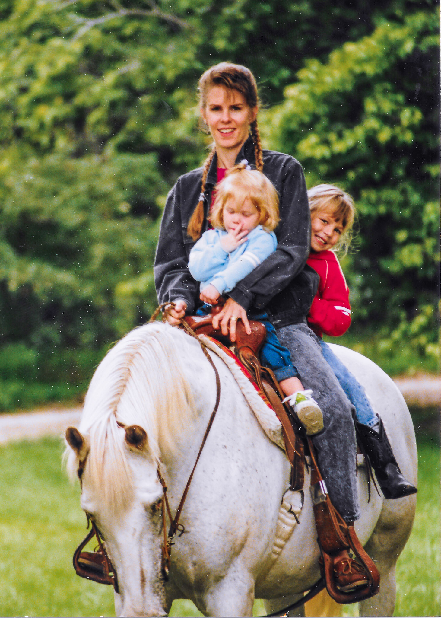 Melanie, with her young daughters, riding Polka.