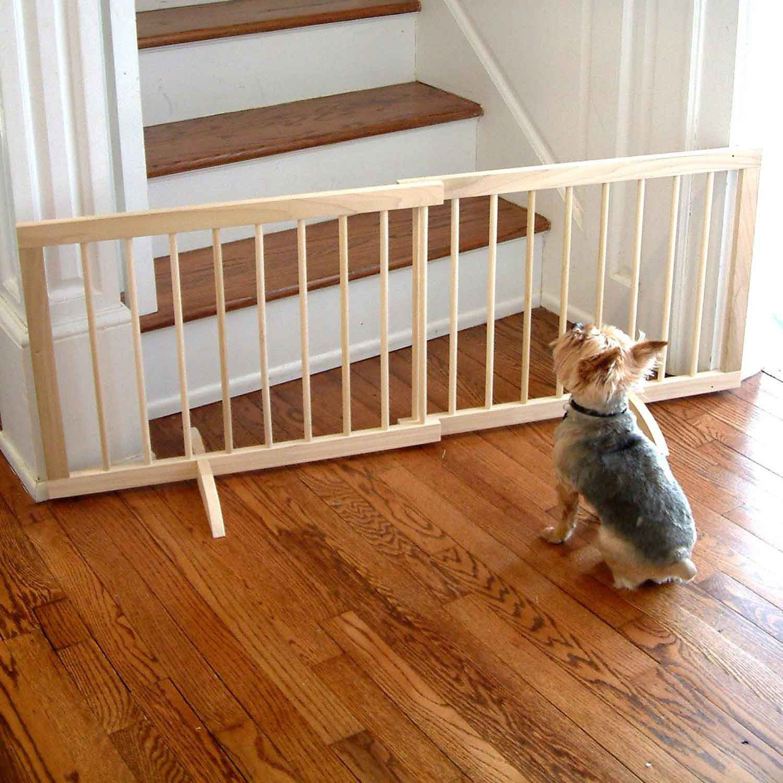 Pet gate blocking unsafe area for senior dog.