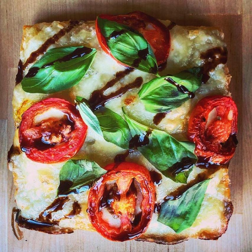 Margherita - fresh mozzarella / tomatoes / basil / garlic salt / olive oil / balsamic drizzle