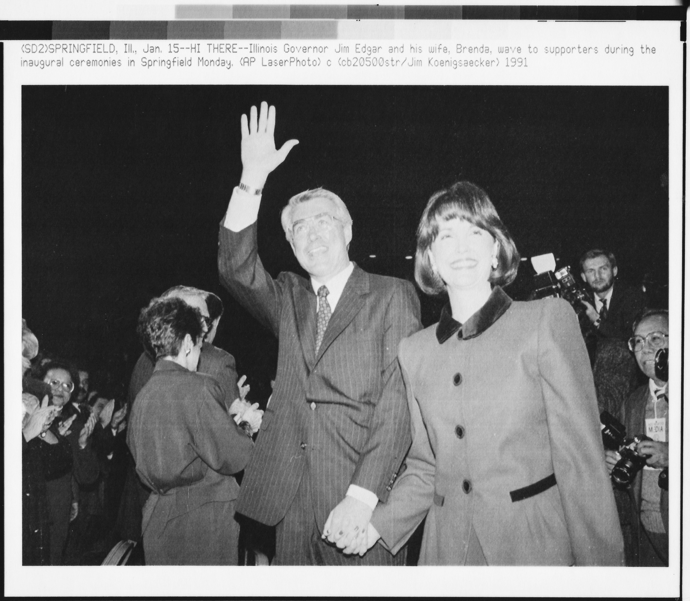 Illinois Governor Jim Edgar and his wife, Brenda, wave to supporters during inaugural ceremonies in Springfield, Illinois.