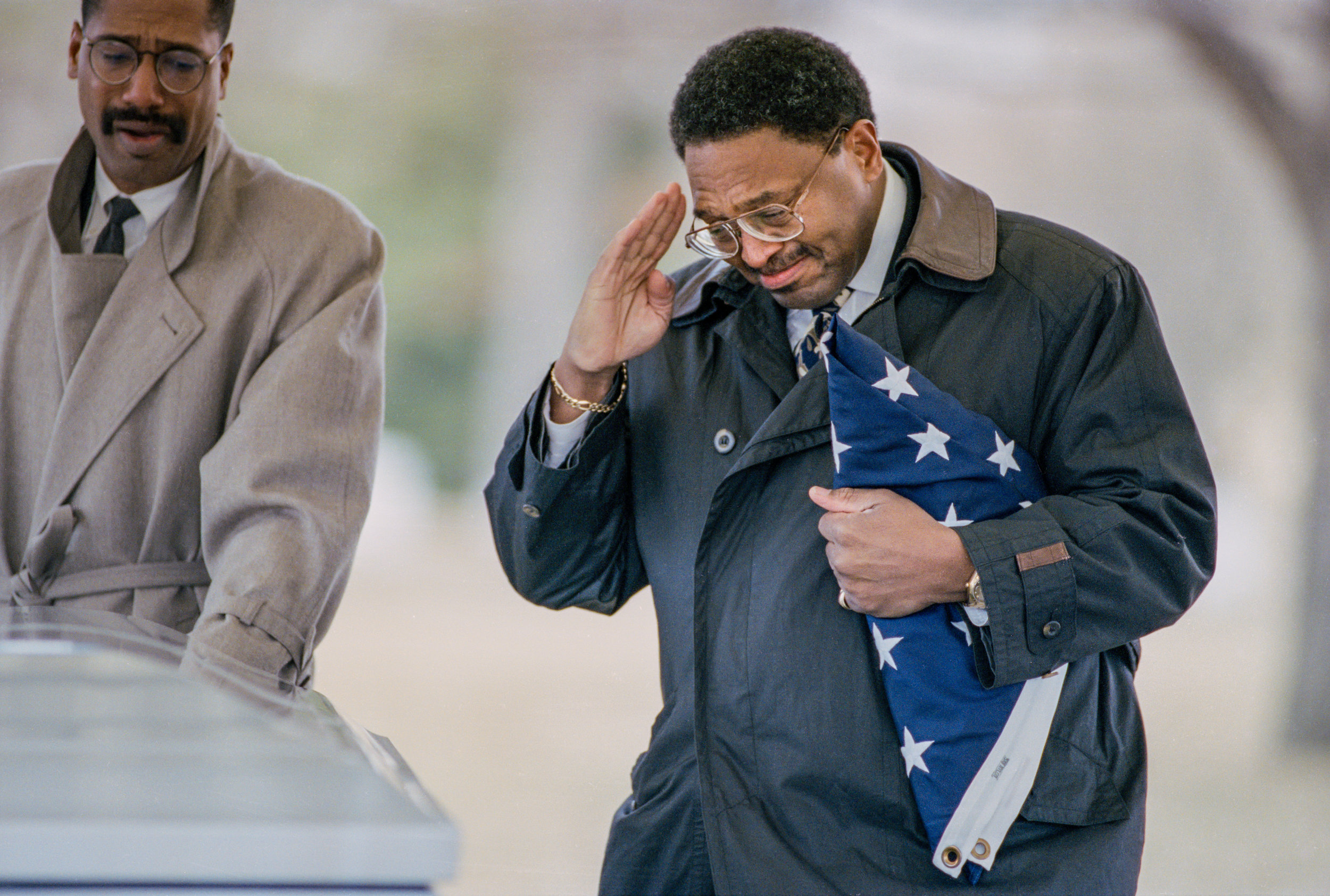 John Porter salutes the casket of his son, Marine Corps Lance Corporal Christian Porter, during funeral services at Camp Butler National Cemetery in Springfield, Illinois