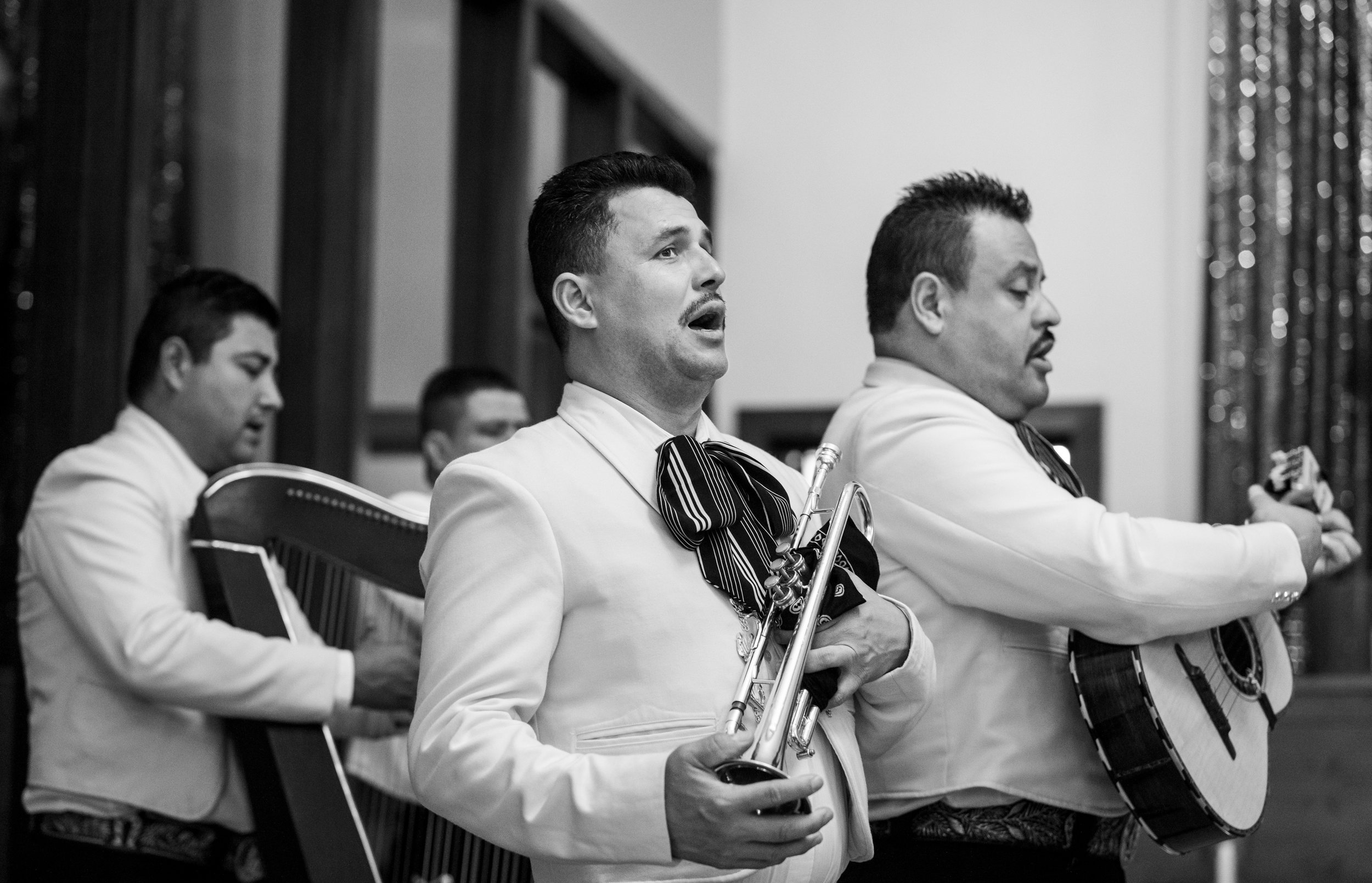 A mariachi group performing during Adriana Gonzalez's quinceañera at Our Lady of Guadalupe Church in Sacramento, California