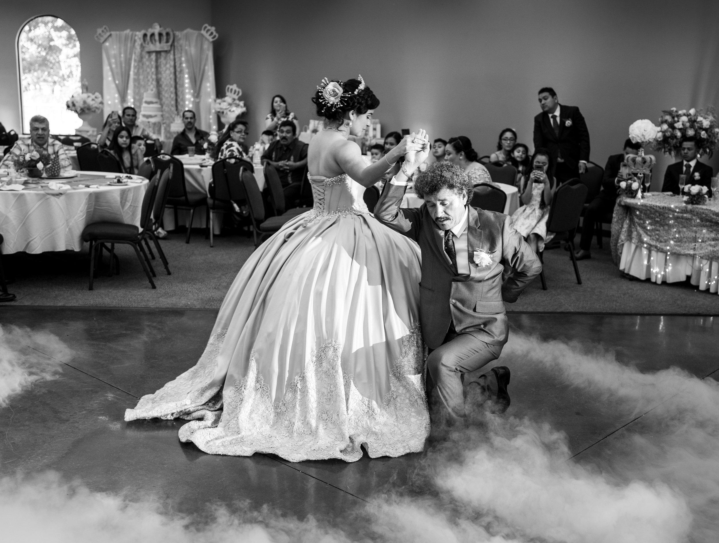 Adolofo Gonzalez and his daughter Adriana Gonzalez waltz during Adriana's quinceañera in Sacramento, California