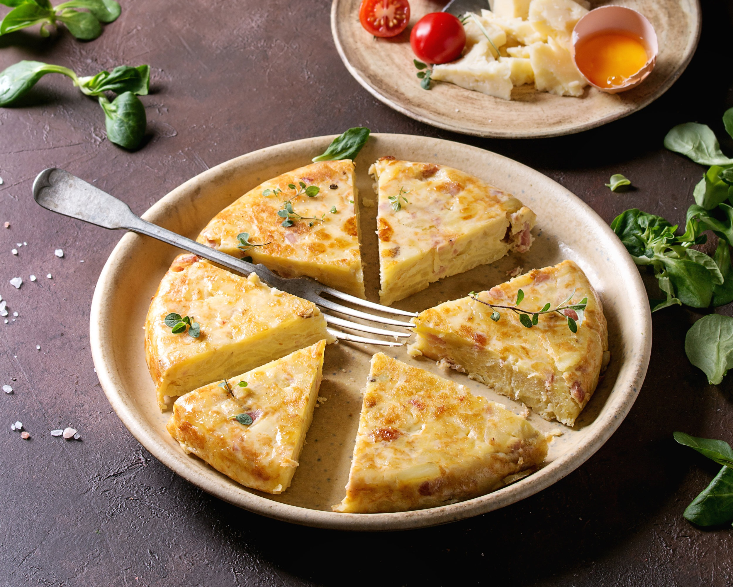 Tortilla Española - Just like an omelette, a simple Spanish tortilla typically has beaten eggs, oil, potatoes and onions.