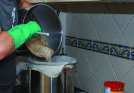 Gently mix your crushed grain into your hot water.