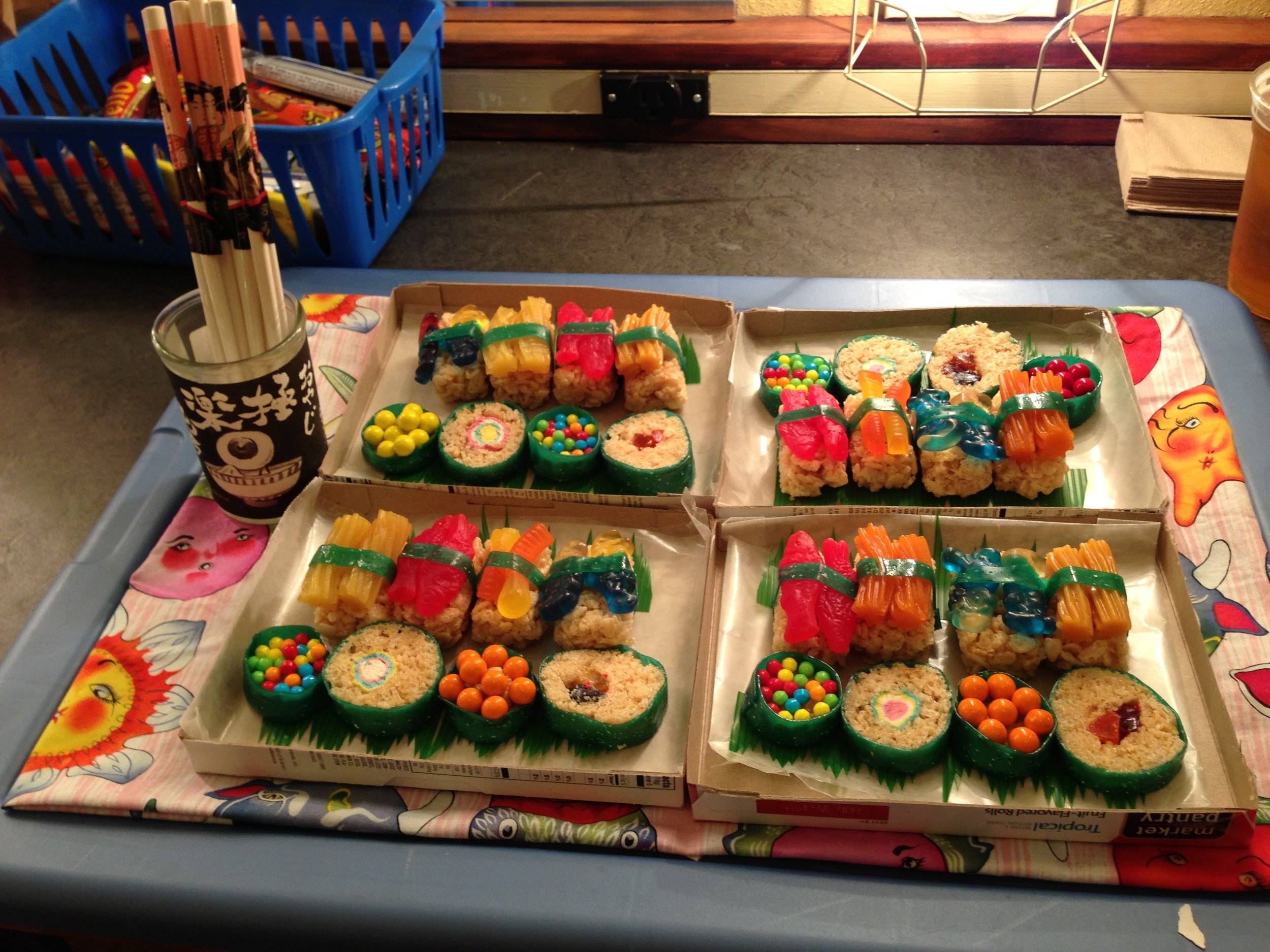 Four trays of painstakingly assembled candy sushi