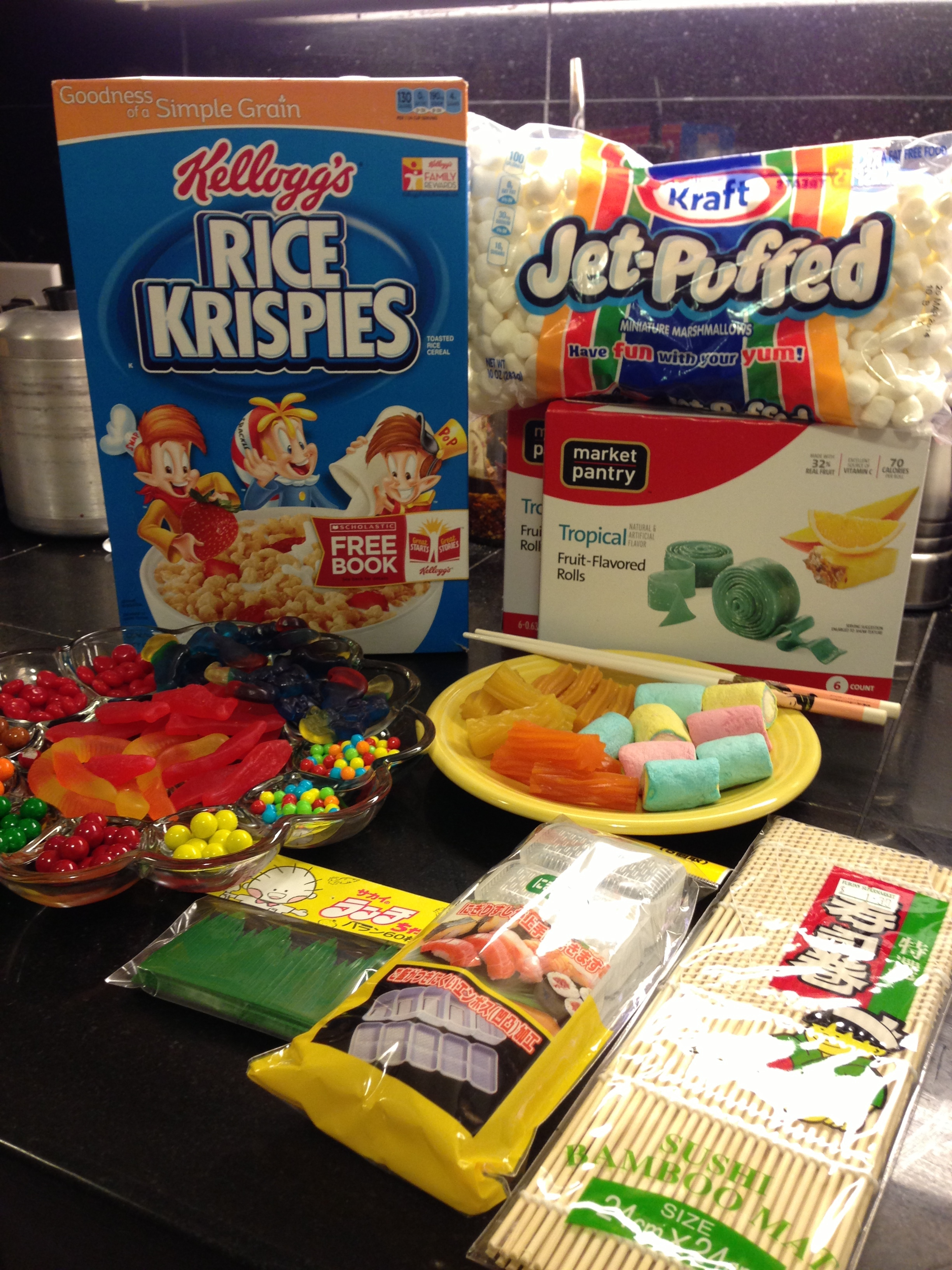 Cereal, marshmallows, candy, and implements of assembly.