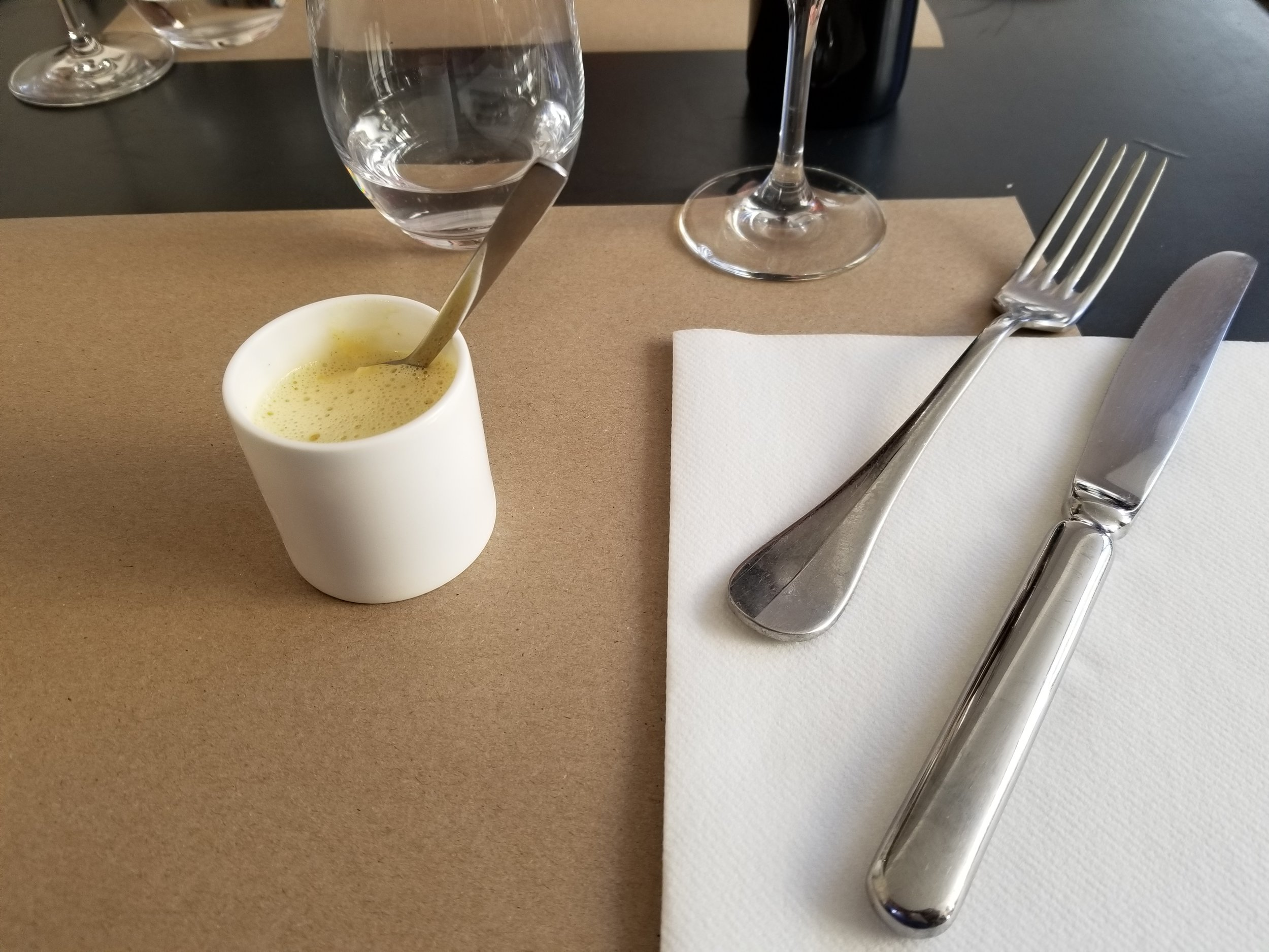 Shortly after we were seated, a server brought us an amuse bouche from the chef, a cup of Royale de Lotte with saffron emulsion