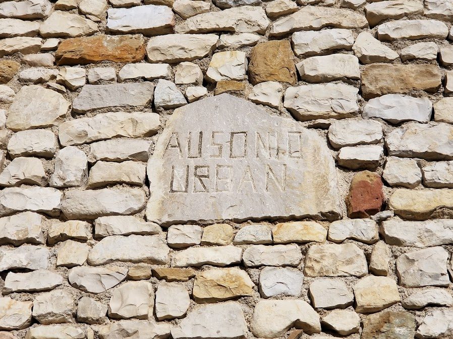 Close-up of stone plate on wall of Sablet House with name of Stone Mason