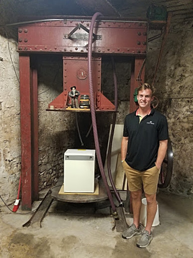 Taylor Harrison in the cellar at Paul Roumanille Winery
