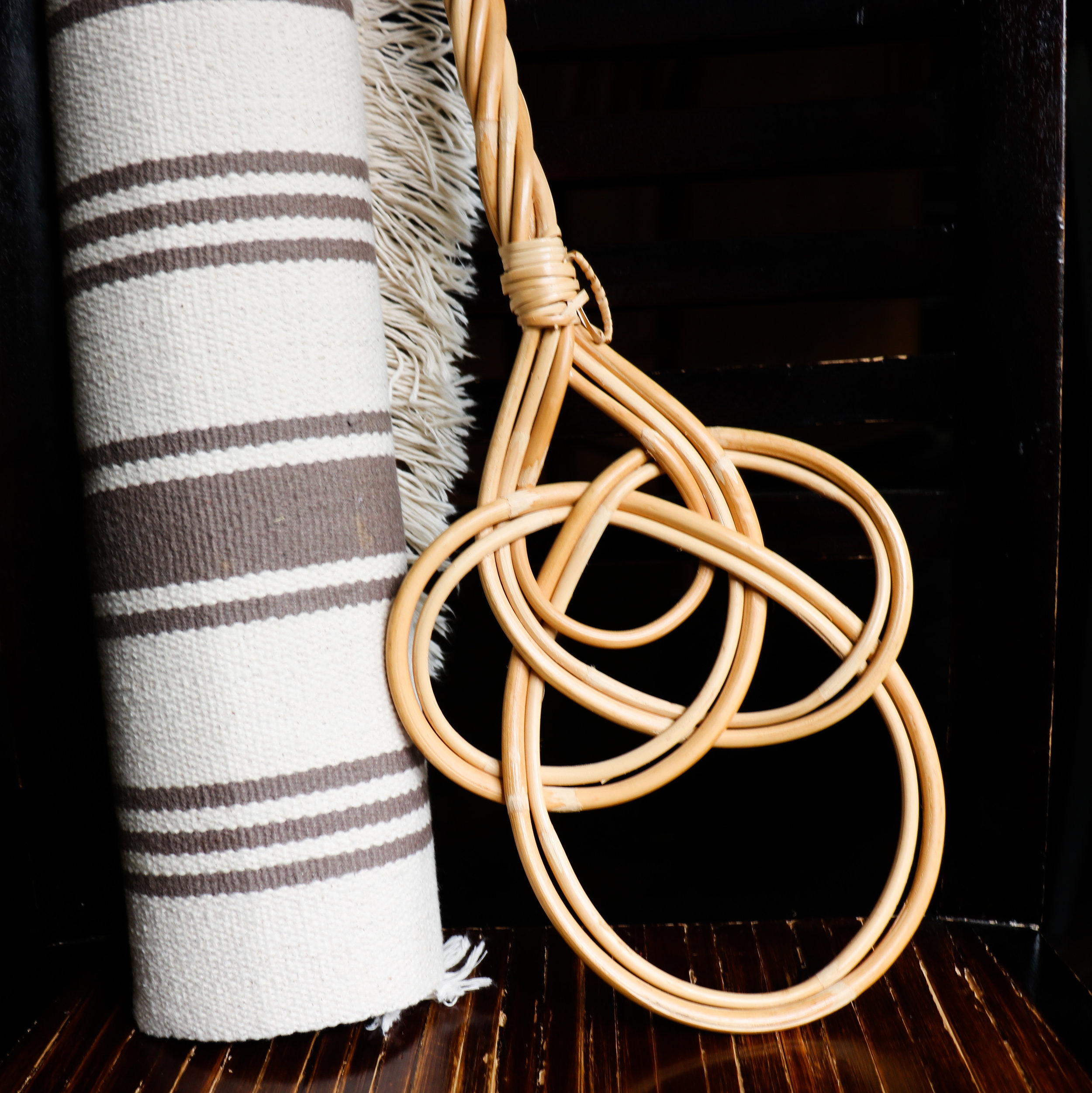 A neutral coloured rug and a Finnish rug beater
