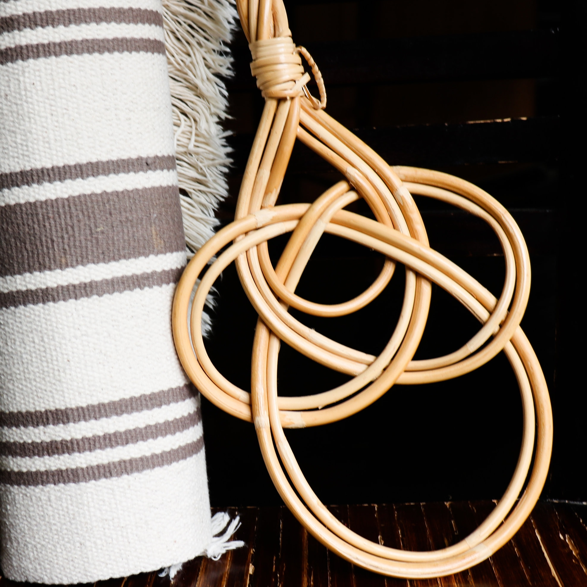 A beige rug with a Finnish rug beater
