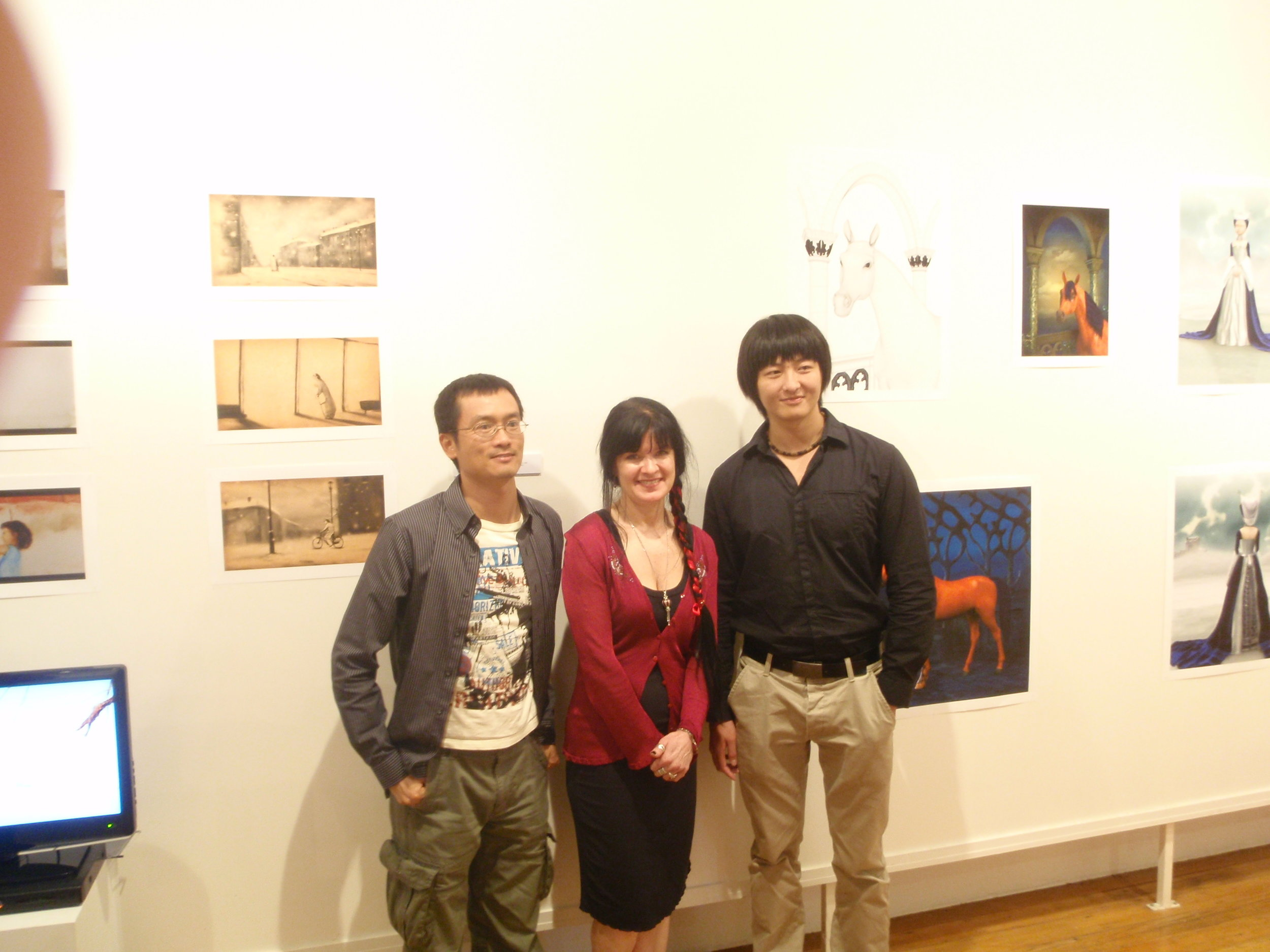 (Jimmy) Zhi-ming Su, Louise Harvey and Xin Li in front of Xin and Louise's work