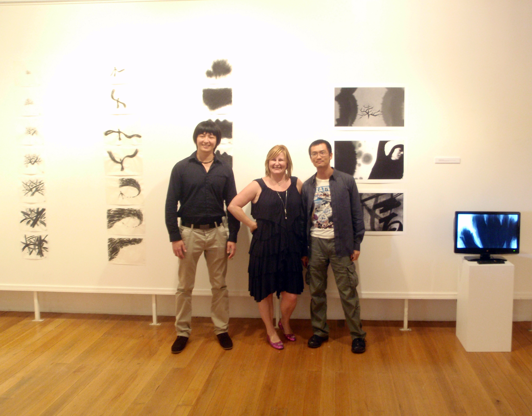 Xin Li, Andi Spark and Zhi-ming Su in front of Jimmy's work
