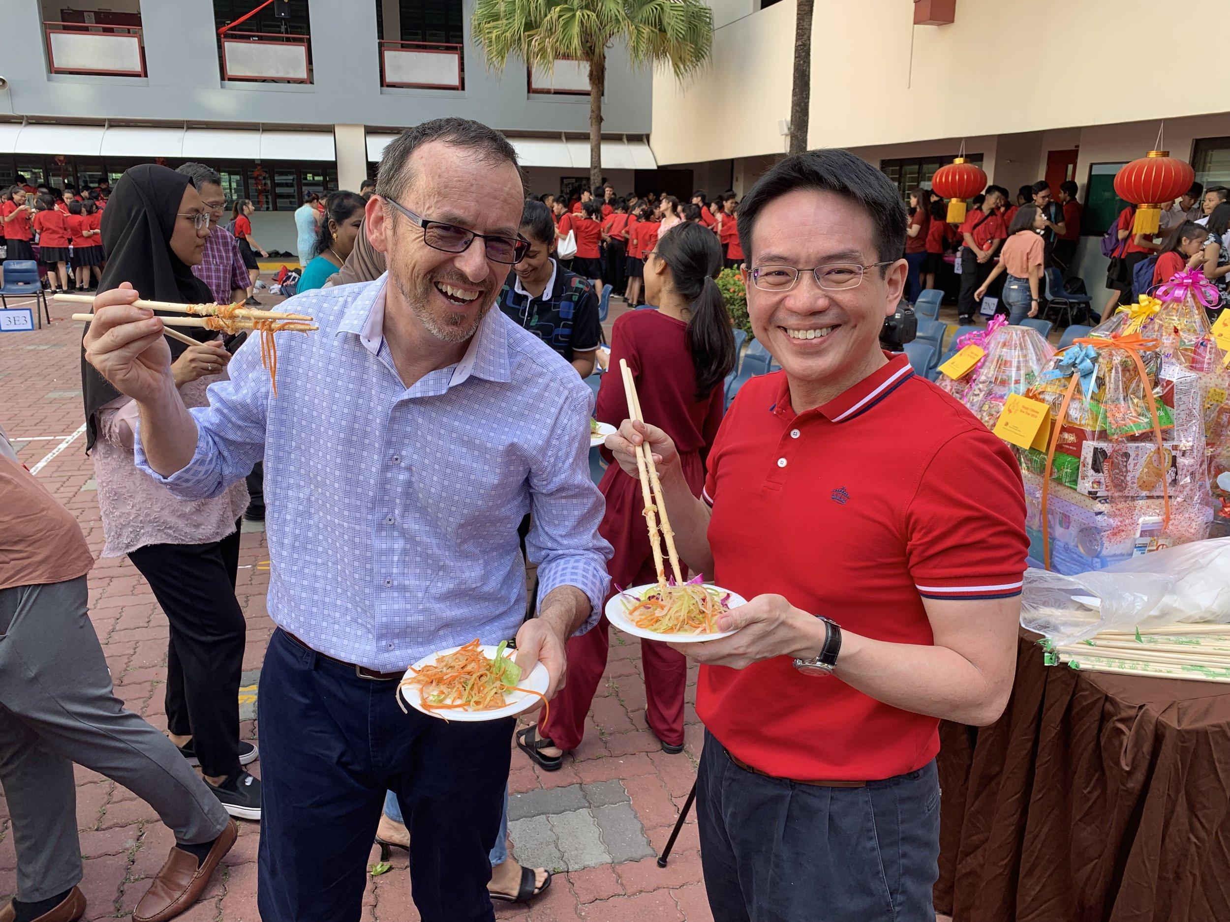 The principal, Mr Eugene Lin and I enjoying the Yee Sang.