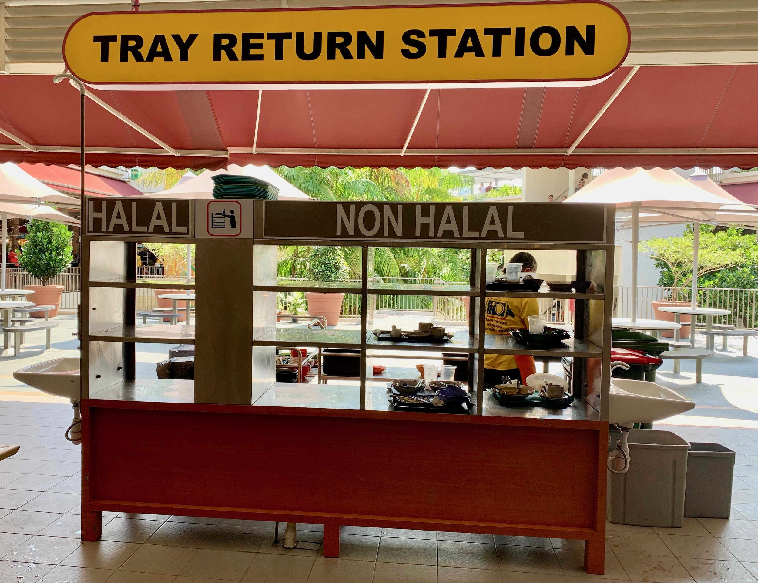 Singaporeans are very considerate of all ethnic groups. Some of the hawker stalls serve halal food, which means it is prepared in a way that adheres to Islamic law. Halal food trays/containers/utensils should not mix with non-halal food items.