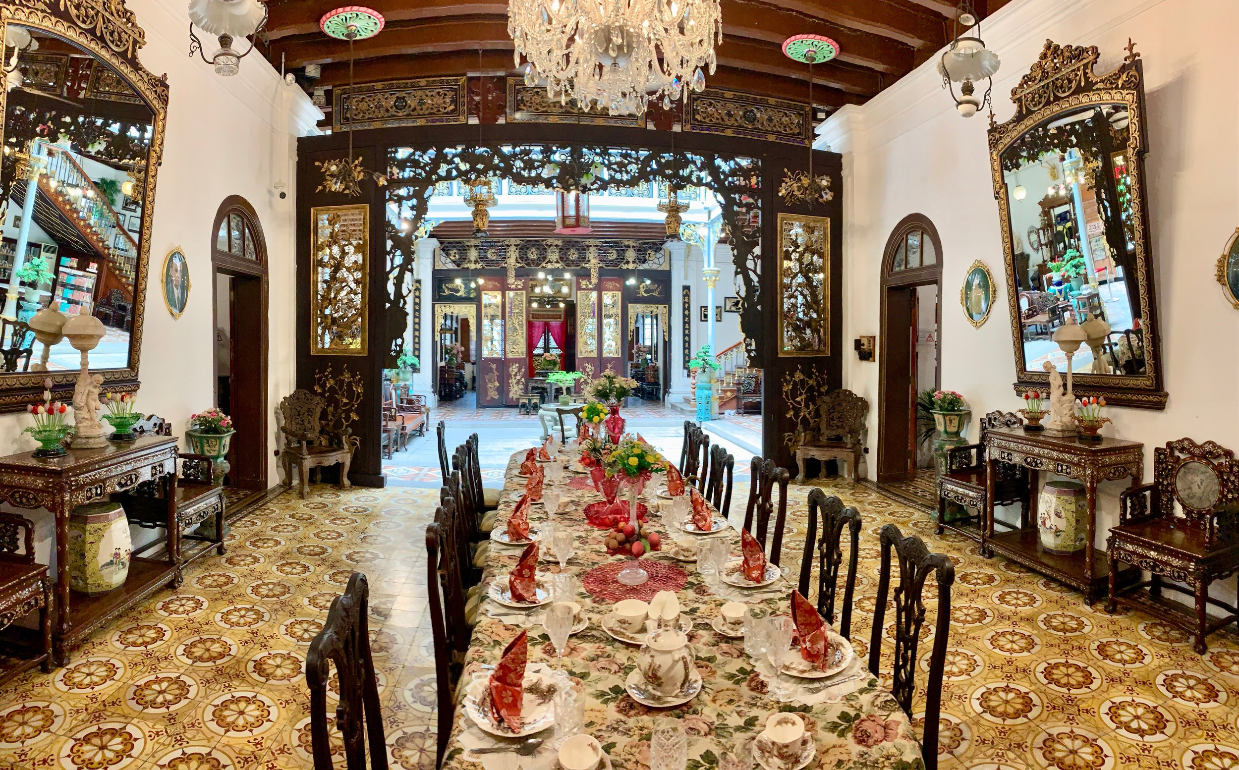 Formal dinning room, looking toward the interior courtyard. The style of tile is traditional Peranakan.