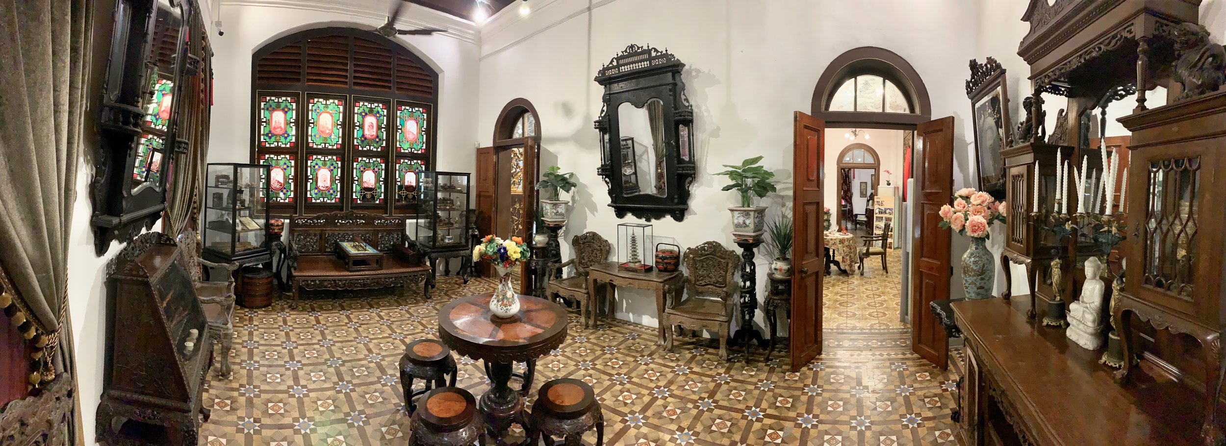 """This is the gentlemen's den. It is to the left of the formal dinning room. After a meal, men might find themselves here. To the left is the sofa/couch where they would lay and """"chase the dragon"""" by smoking opium."""