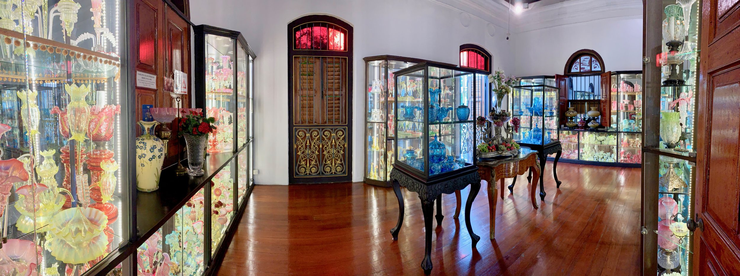 This room contains a display of the some of mansion's glass centerpieces and serving ware, the French name being epergne. All imported from Europe. French on the left and Italian, specifically Venetian Murano glassware worth in the tens of thousands of dollars, on the right.