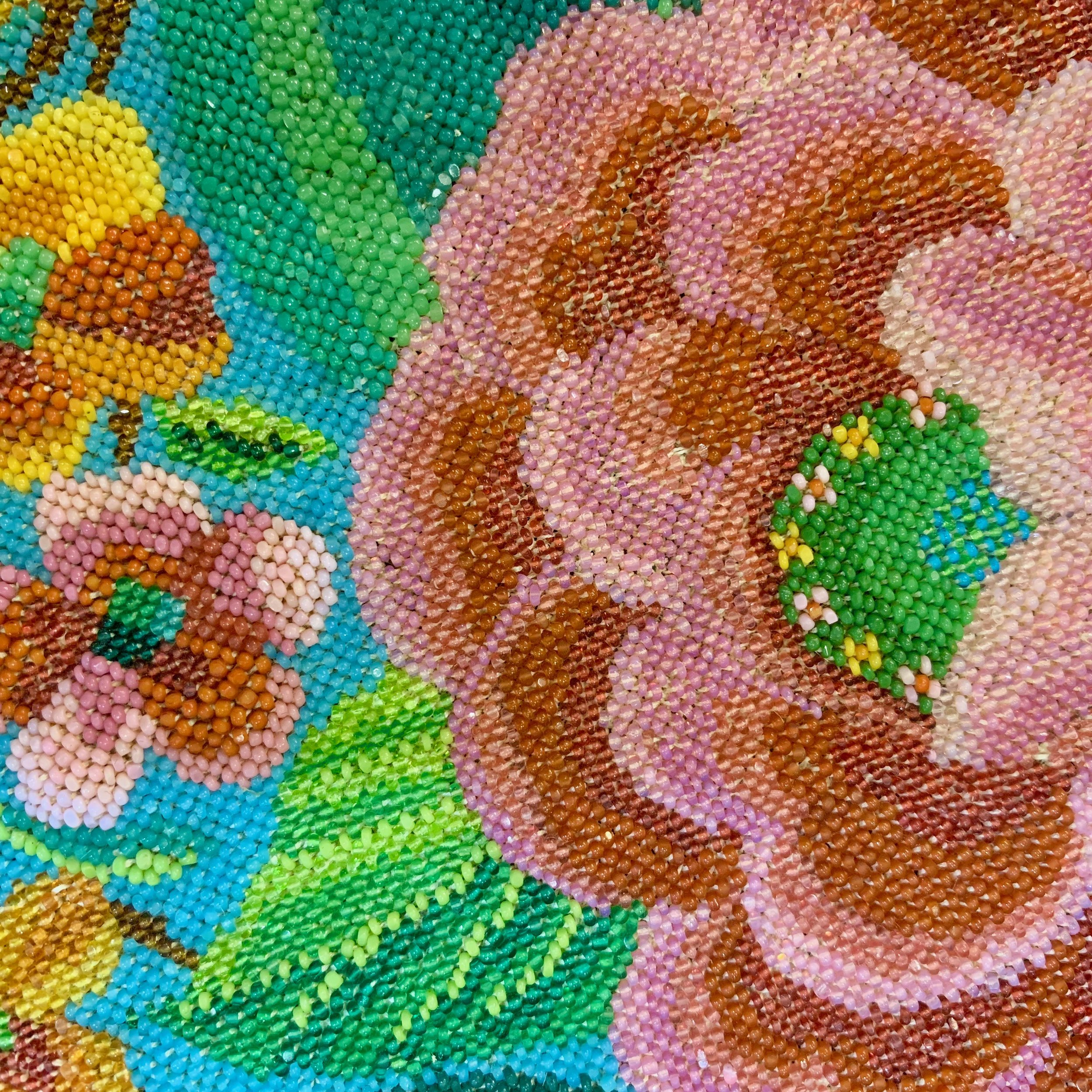 A detailed close-up of the magnificent beadwork sewn onto shoes, purses, and table coverings