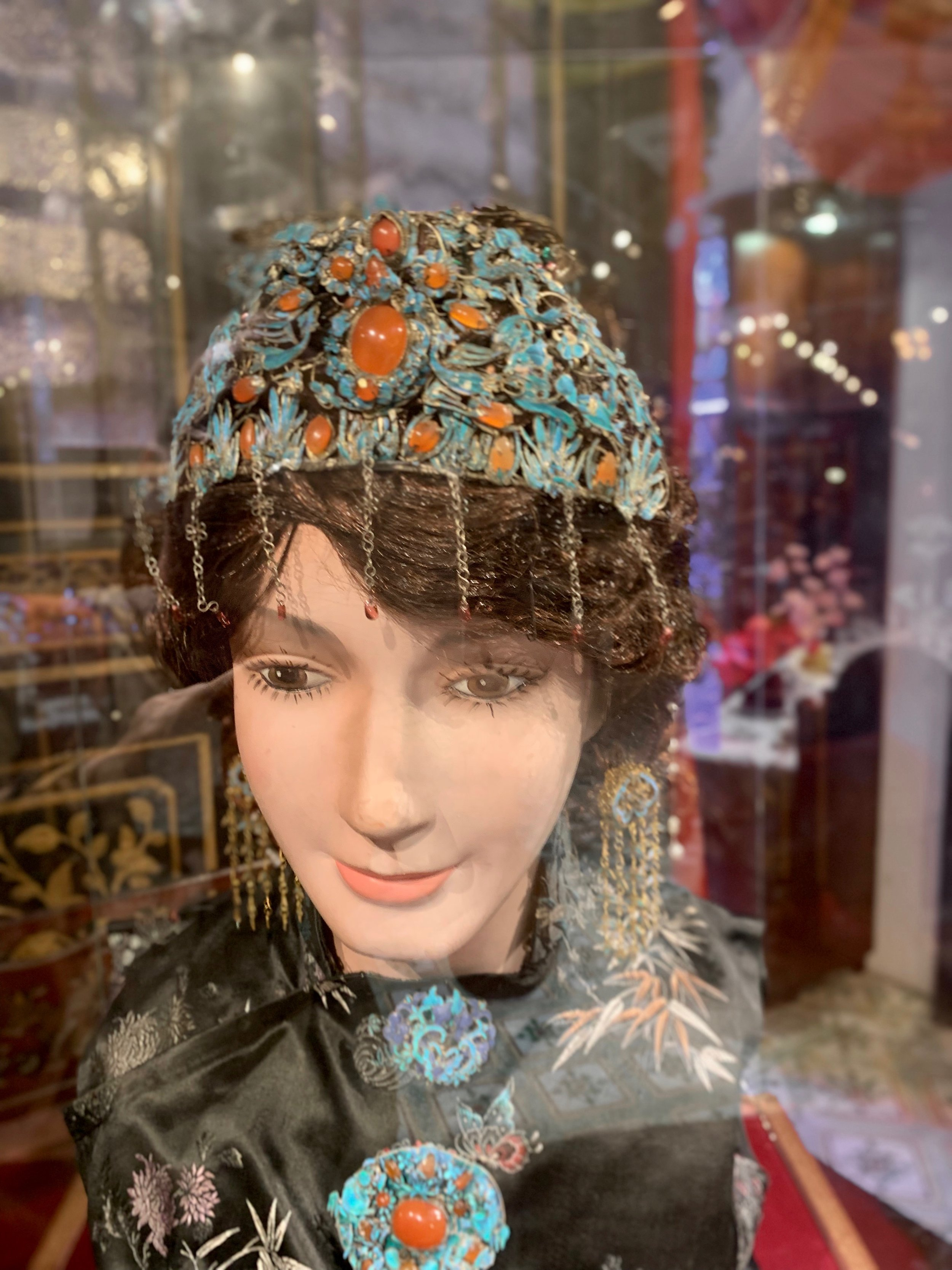This beautiful headpiece is not what it seems. The unique blue color does not come from a mineral. Take a closer look in the next photo.