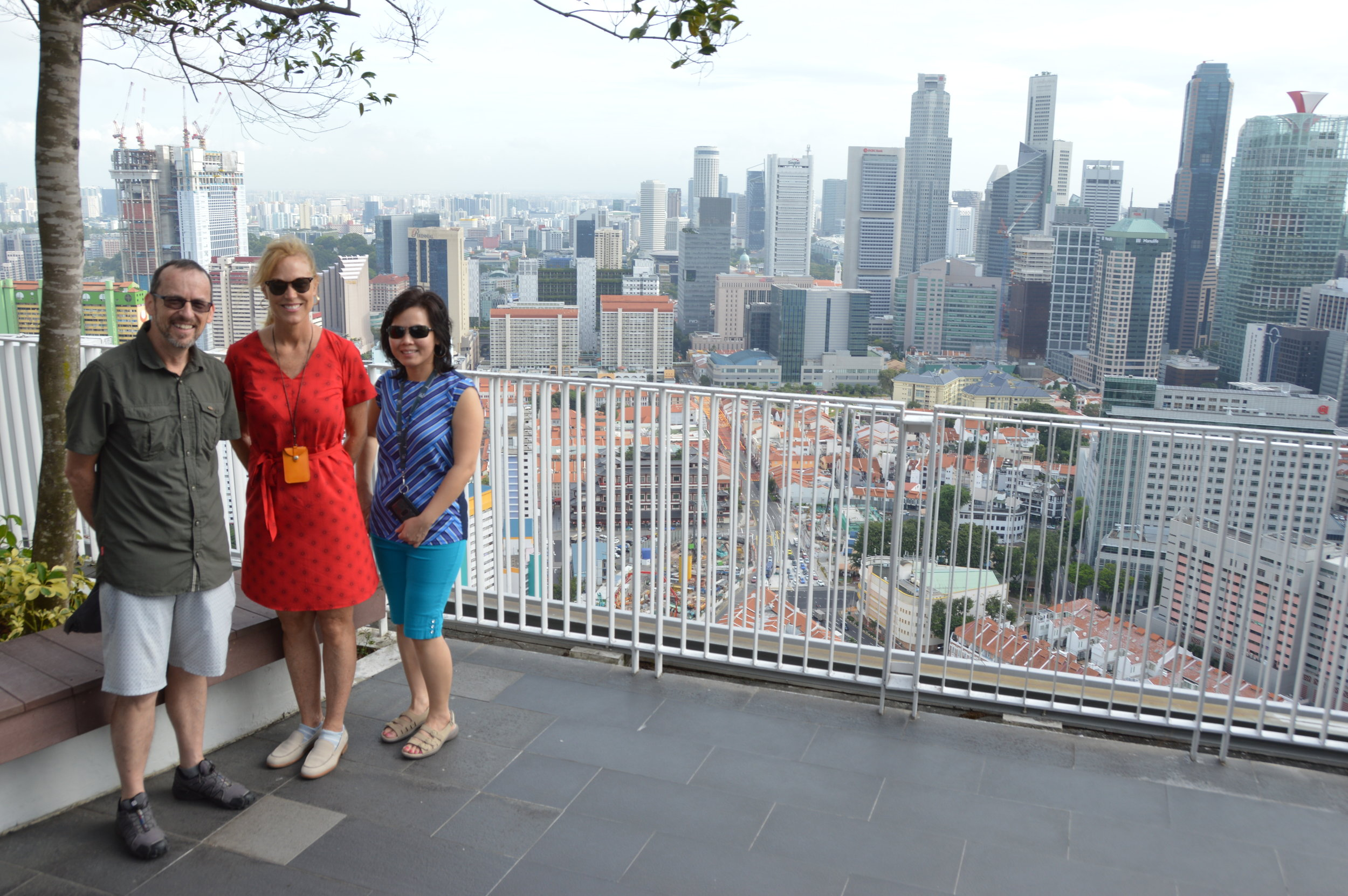 Christine, Diem, and I on top of an apartment building overlooking old Chinatown surrounded by modern Singapore.
