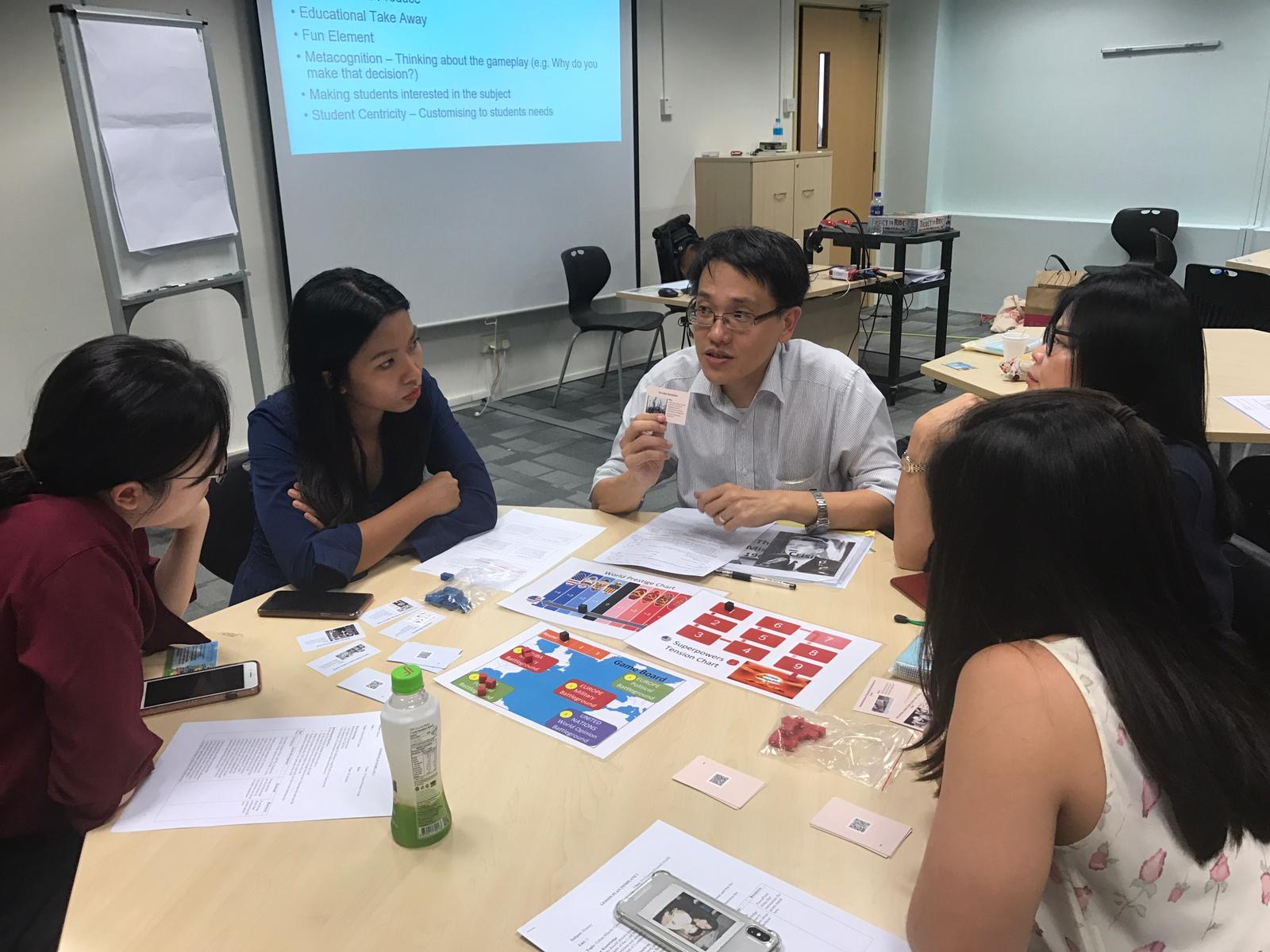 Teachers play testing a game during my Fulbright research project in Singapore.