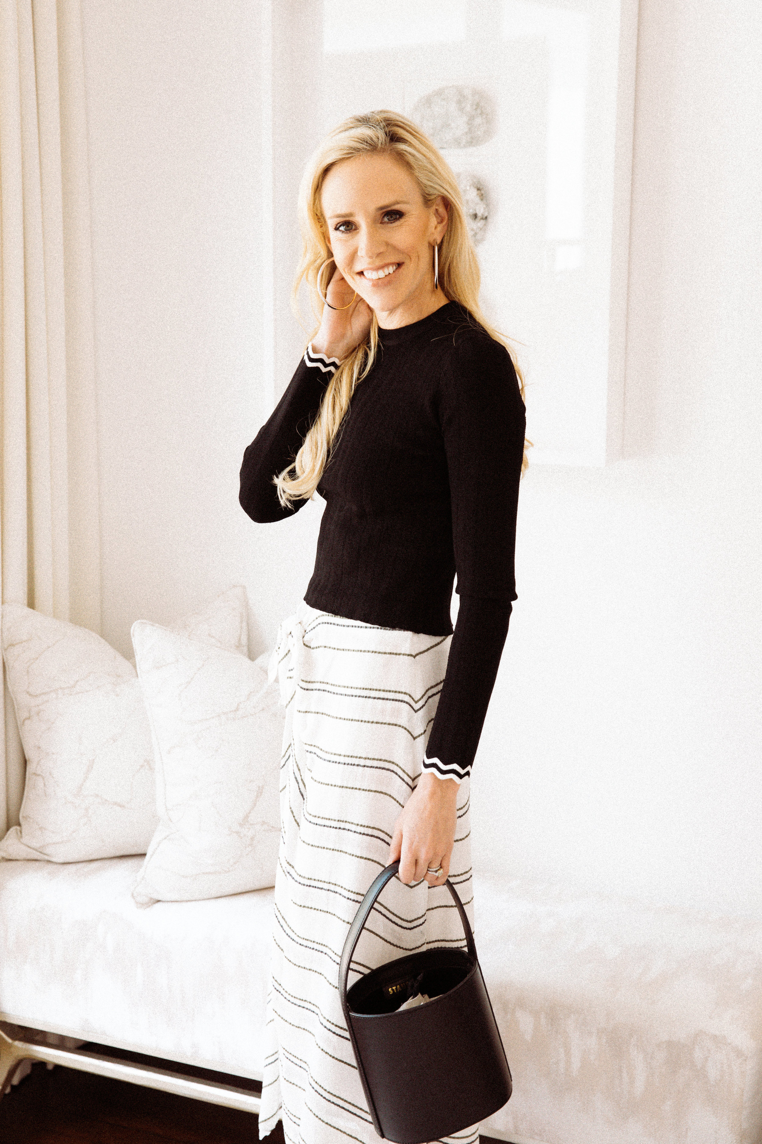 When freezing winter days warm up to cold spring weather, what's a girl to wear?  Cue the ever-so-versatile transitional spring outfits for 2019. Transitional pieces take you from winter to spring with style and grace. They hint that true spring colors and fabrics have (almost) arrived, but are savvy in knowing that this time of year promises fluctuation in temperatures. While you may be questioning when to start dressing for spring and what to wear on those chilly spring days, I've got you covered with everything you need from transitional spring shoes to lightweight jackets and everything in between!