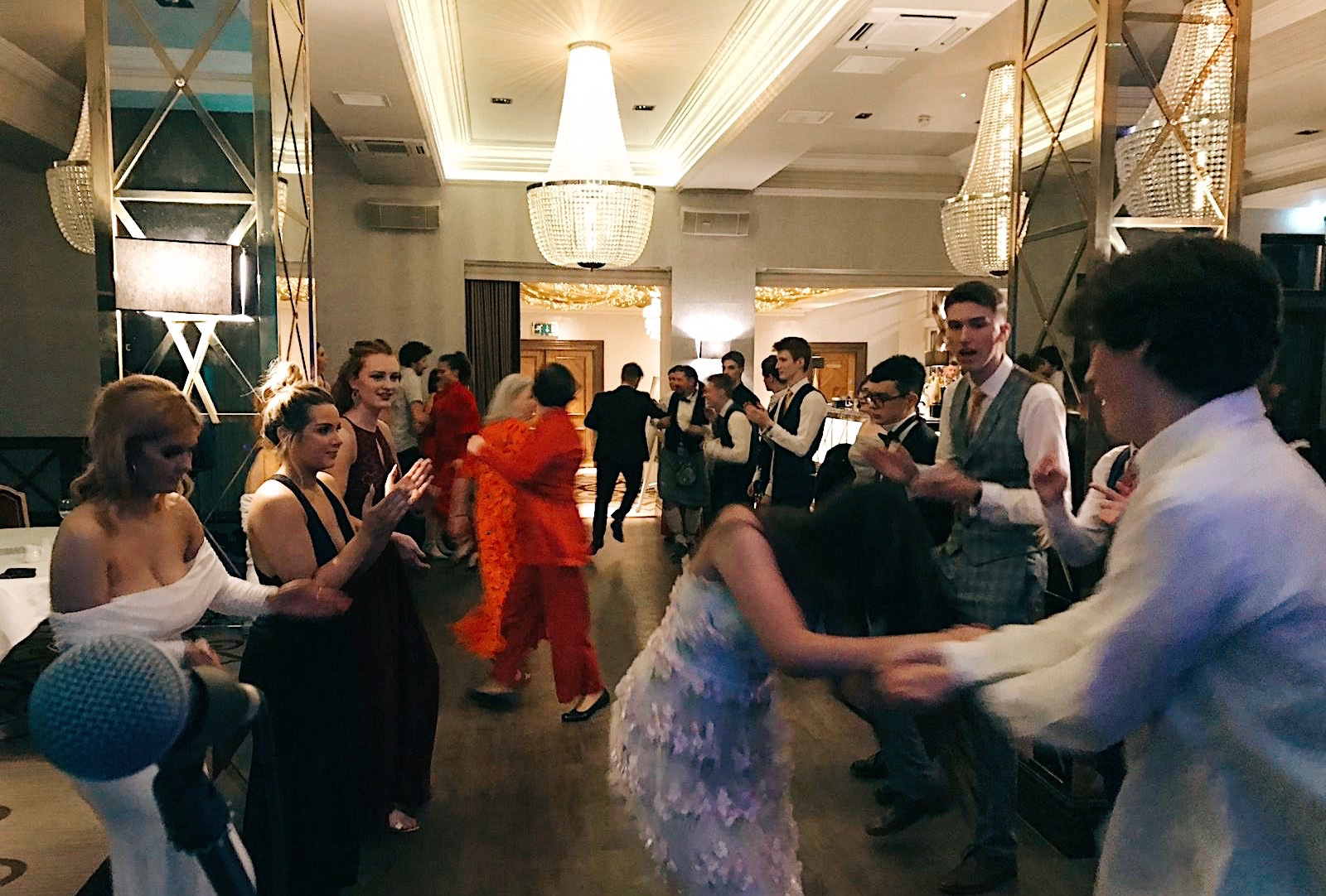 Enthusiastic dancers giving it laldy at their prom