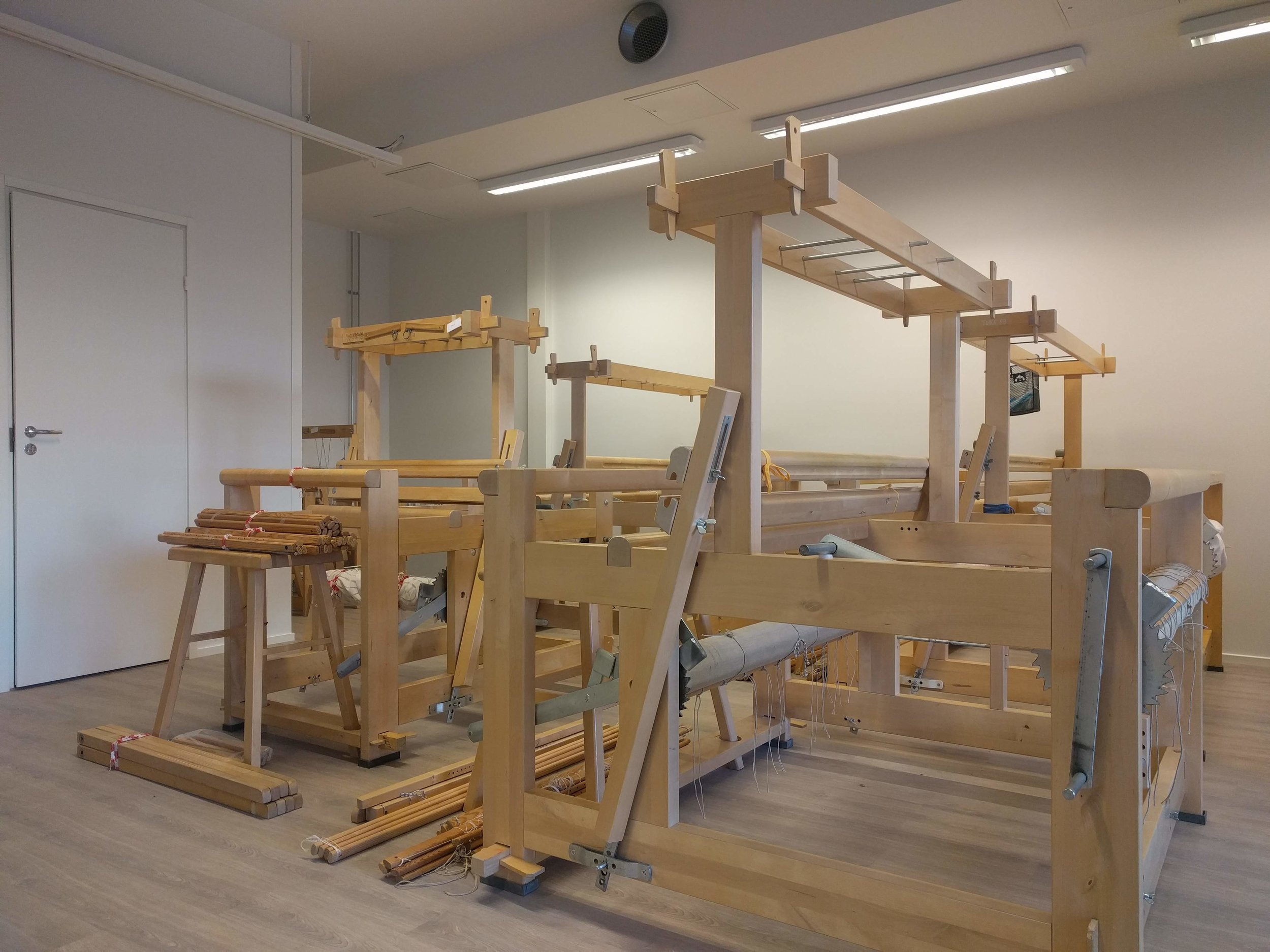 These are some of the floor looms in the studio. Most of them are countermarch looms from the Finnish brand Toika.
