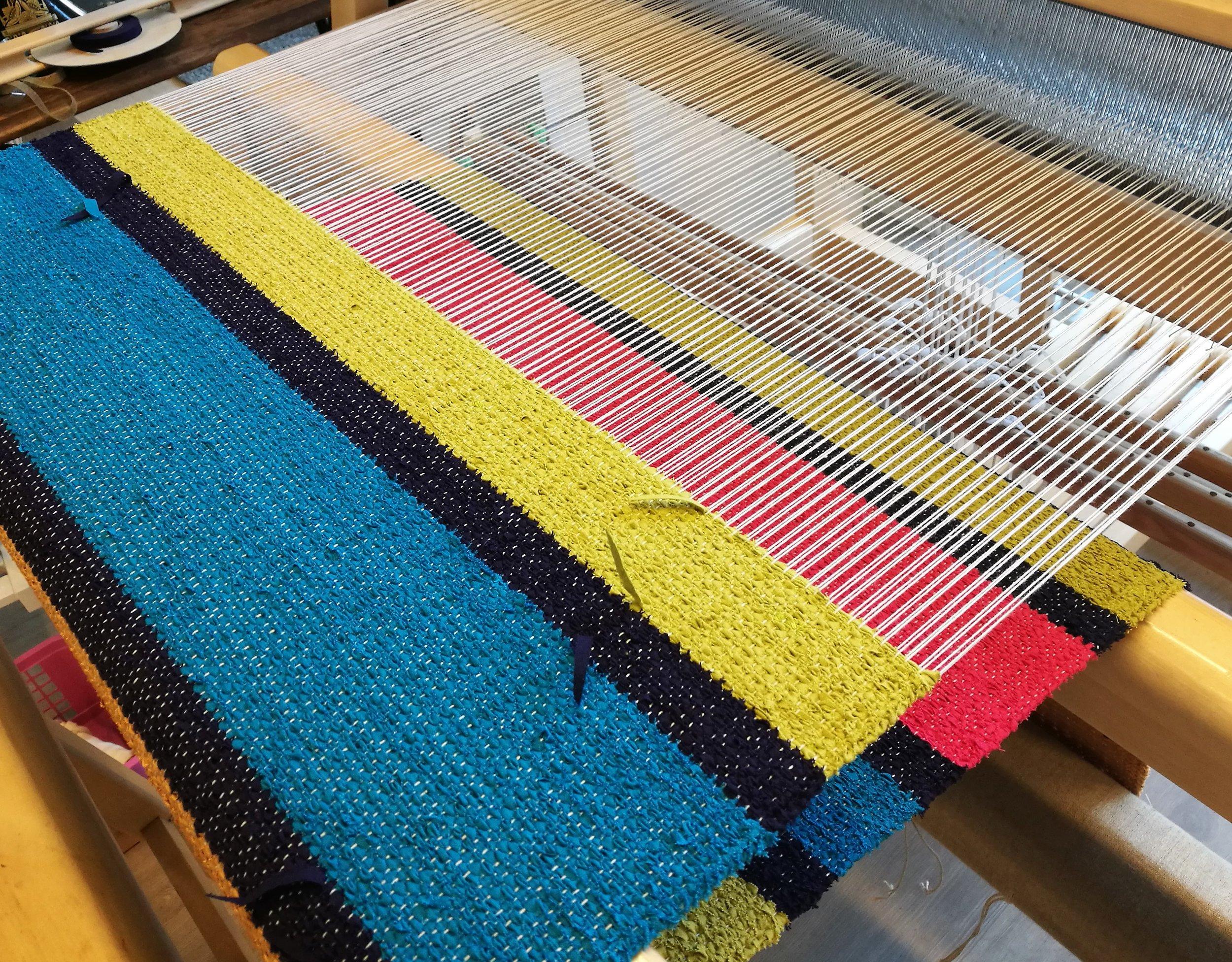 Stripy poppana fabric on the loom