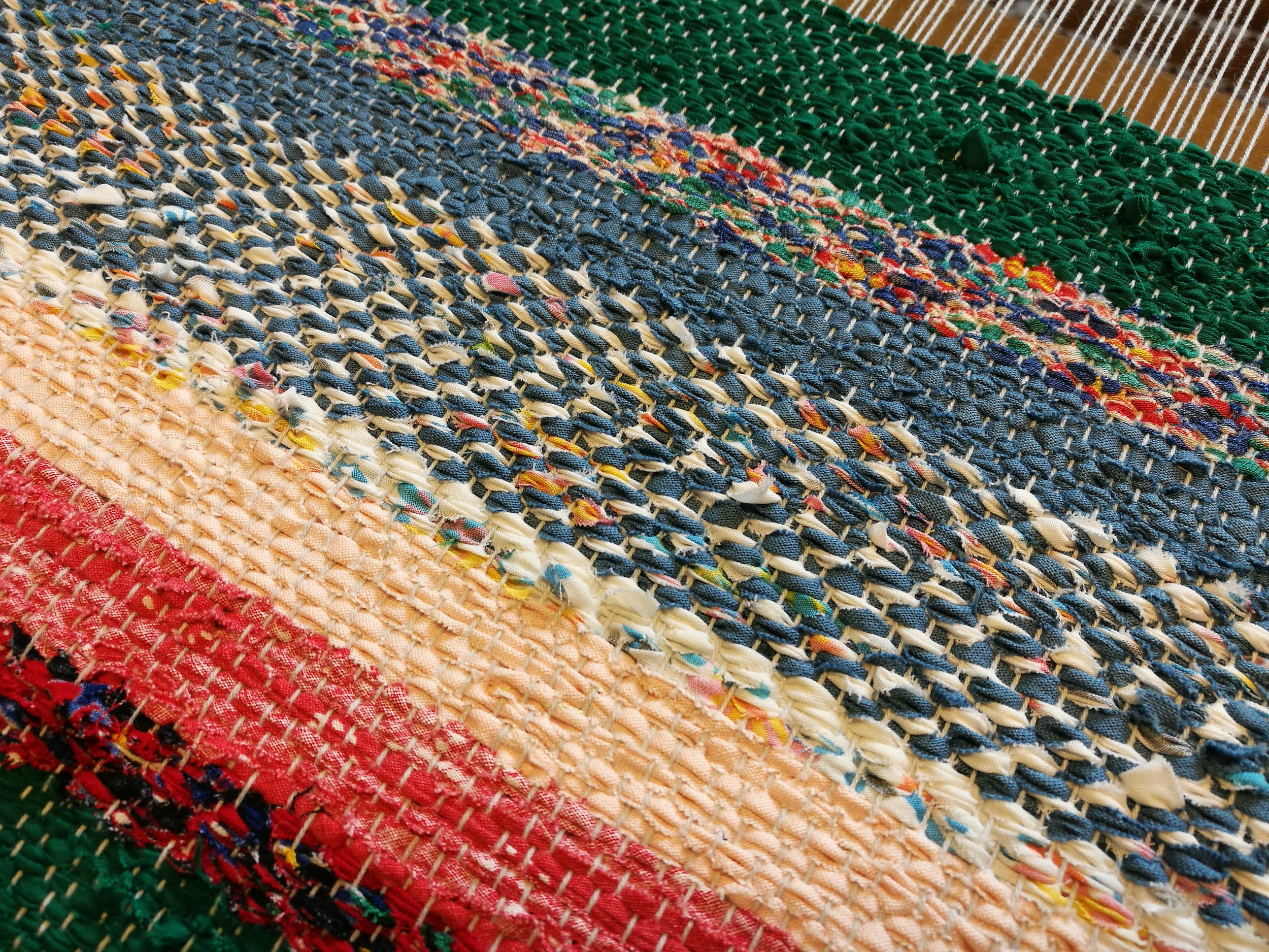 A sample that has been woven with different materials in plain weave and twill patterns