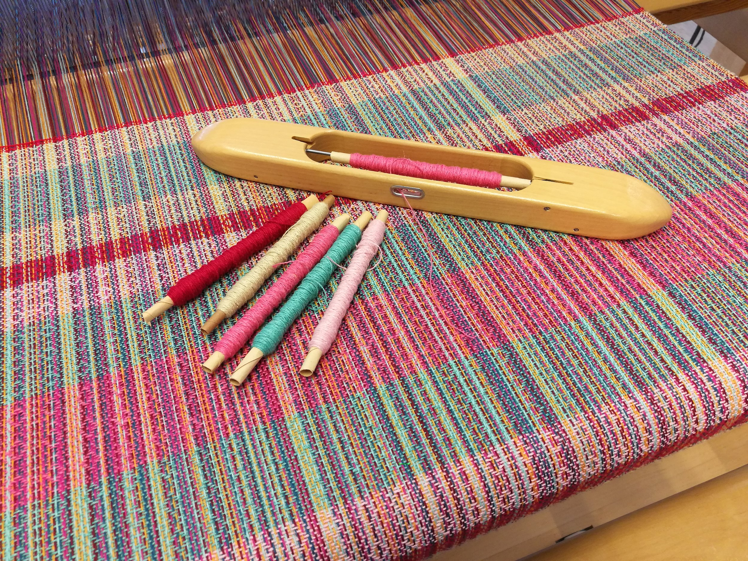 Fabric woven with different colours