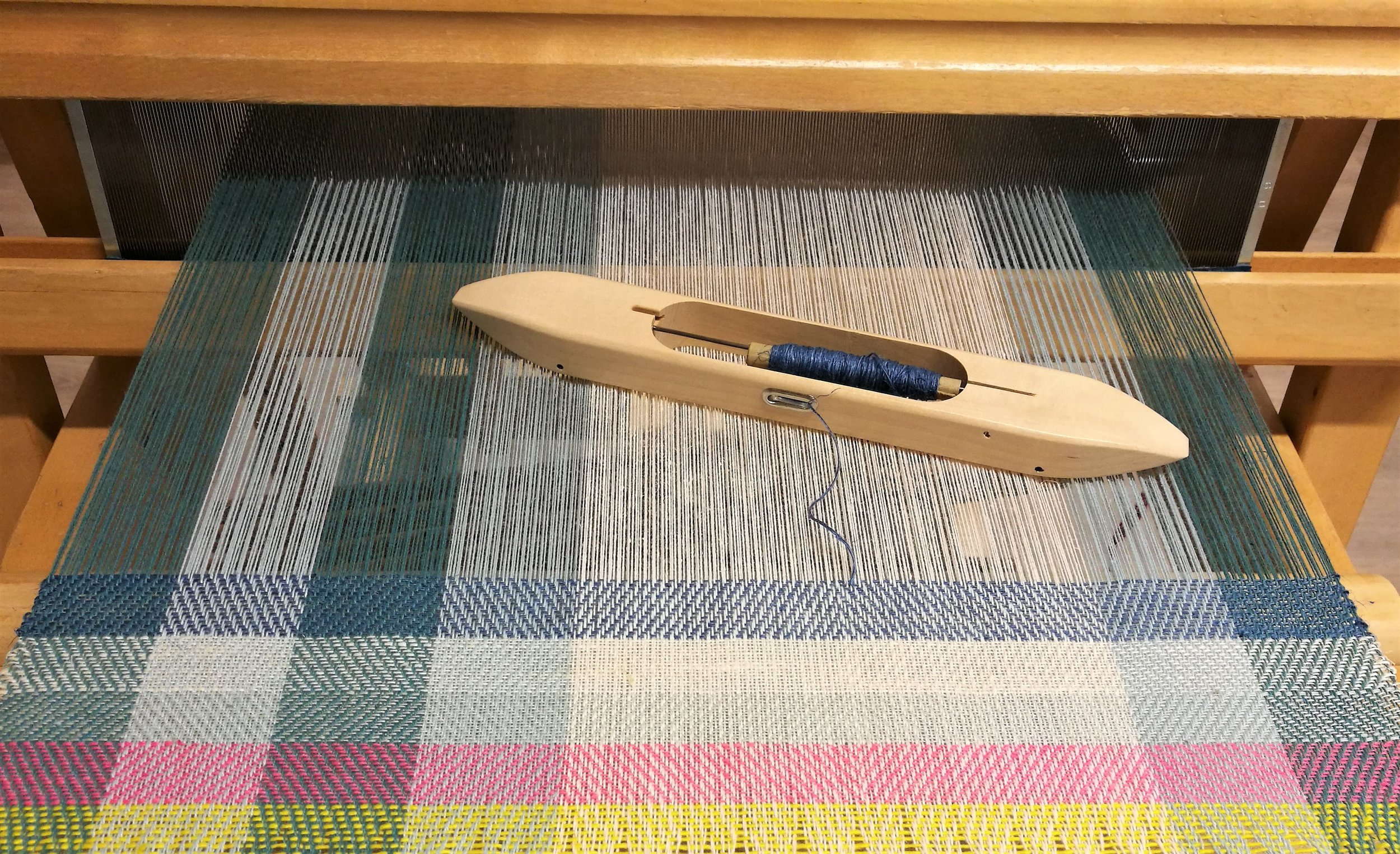 The warp has a twill pattern and a colour block design.
