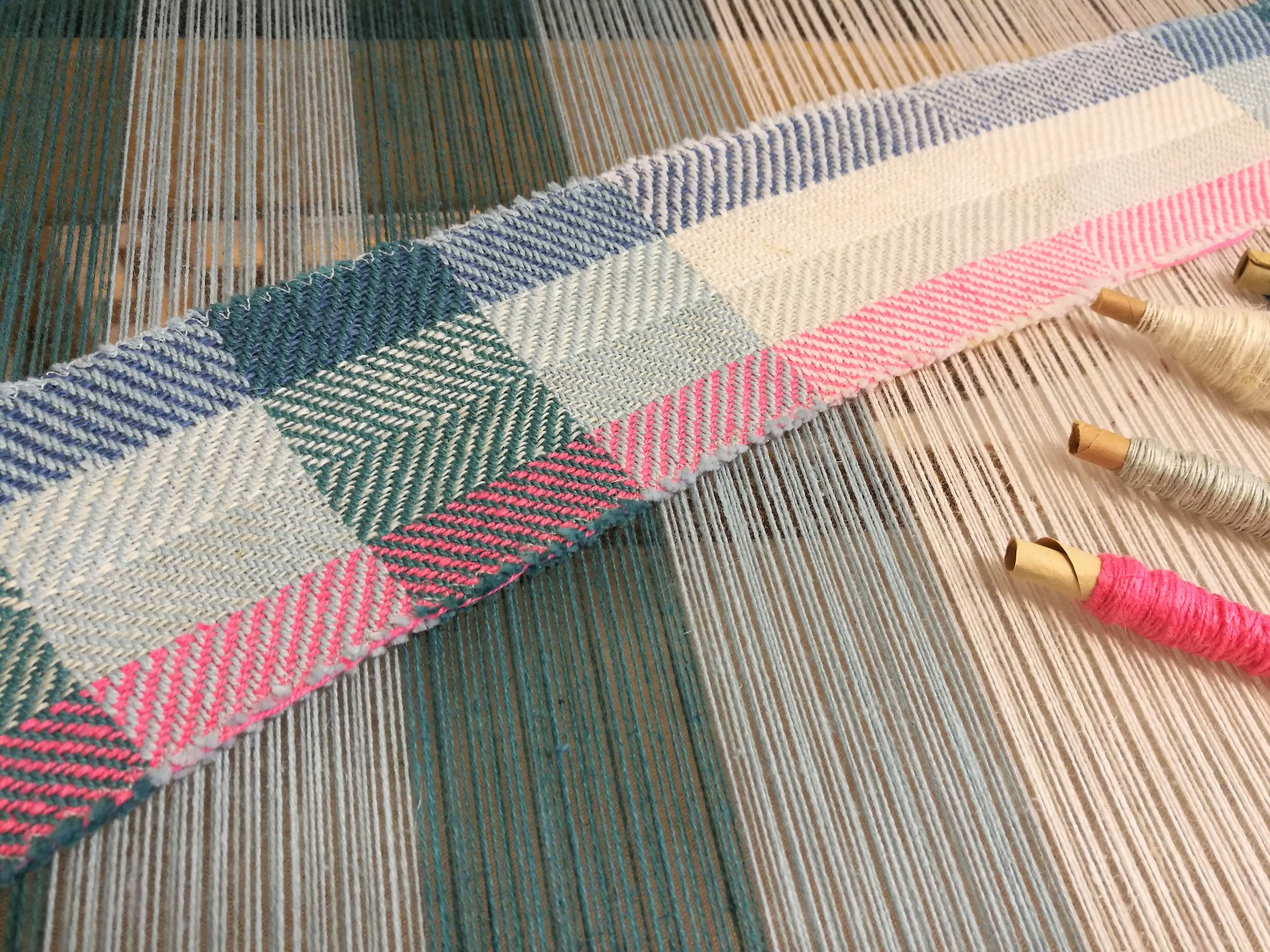 A sample woven with different weights of linen and cotton-linen blend yarns