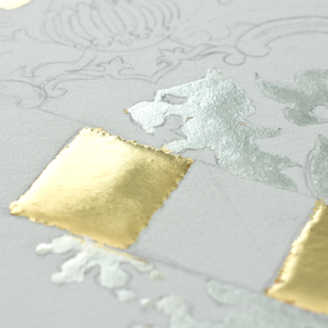 A cushion of Miniatum in yellow gold beside an area of white gold done in Miniatum ink. -