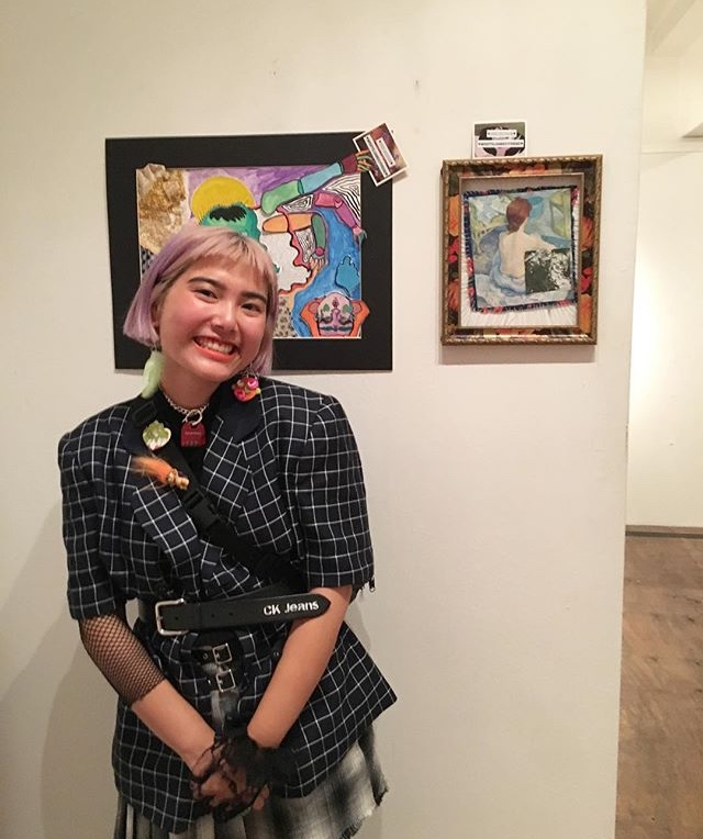 Photograph by Sydney Sweeney, Jess Aquino next to her work, at Color Theory Club II