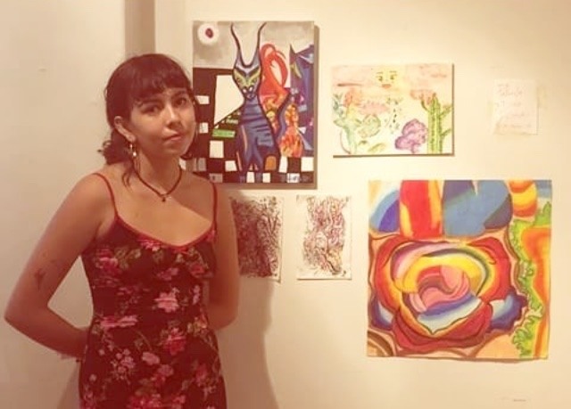 Paloma Diaz next to her work, at Color Theory Club II
