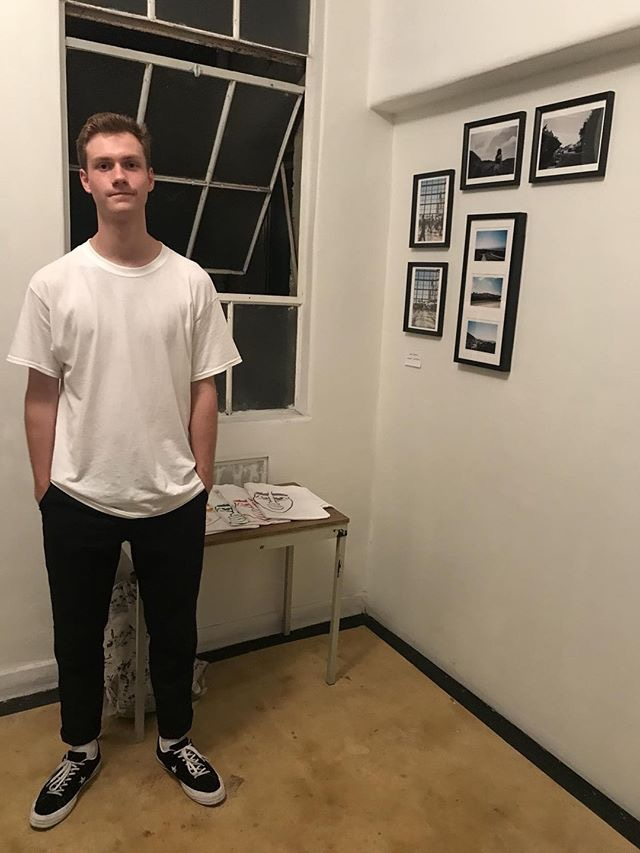 Photograph by Roy Freiha, Sam Beadle next to his work, at Color Theory Club II