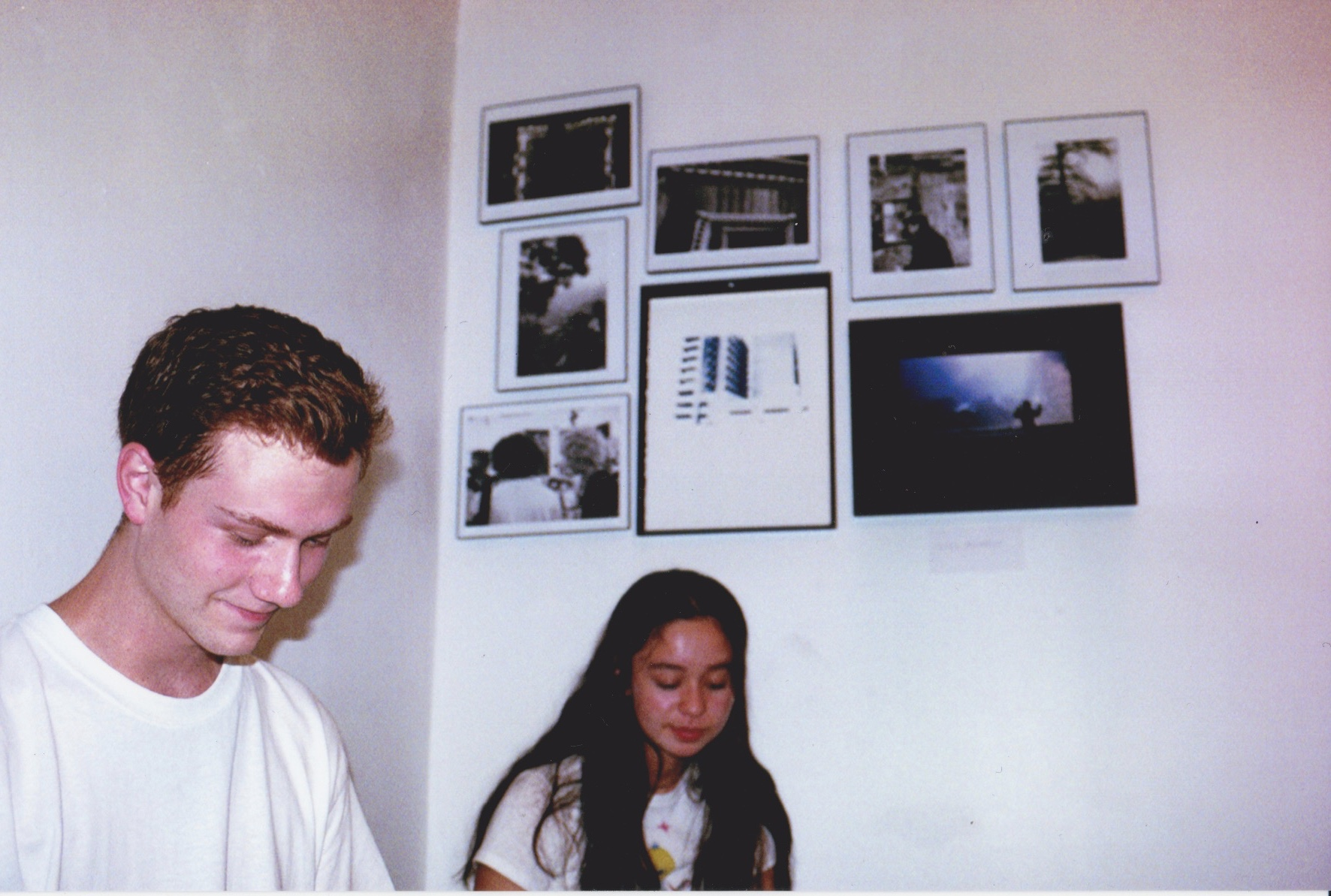 Viviana Alvarez (right) with her photographs at Color Theory Club II