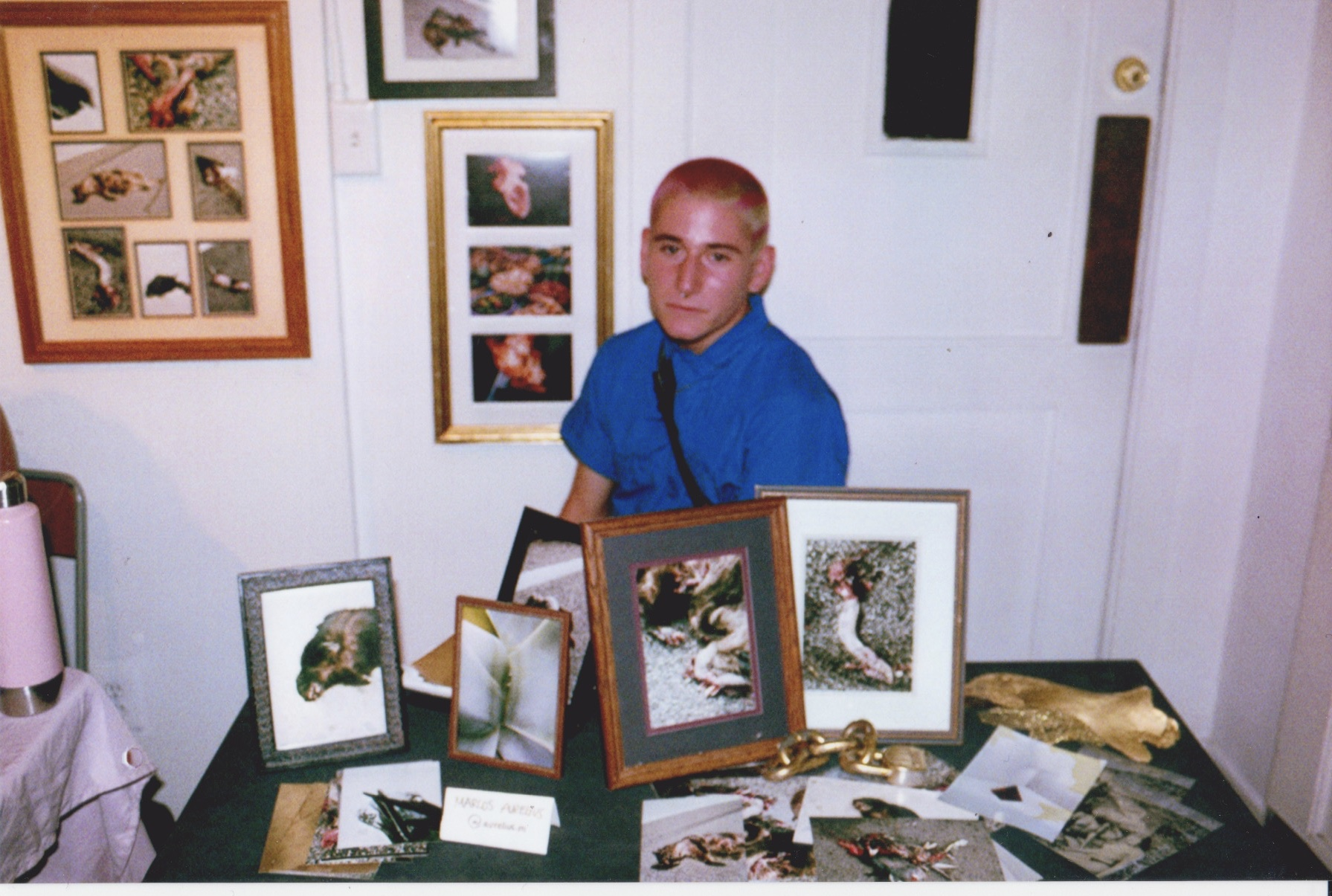 Marcos Aurelius with his photographs at Color Theory Club II