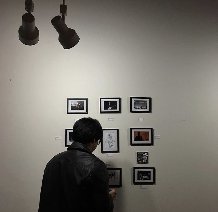Hector (@sriosly) with his work at Color Theory Club III, photograph by @flowerdive