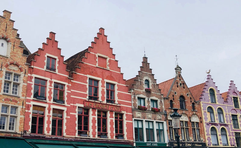 Colorful row of buildings lining Grote Markt. (Earthtones Travel + Design Blog - Roo Bea Design Co)