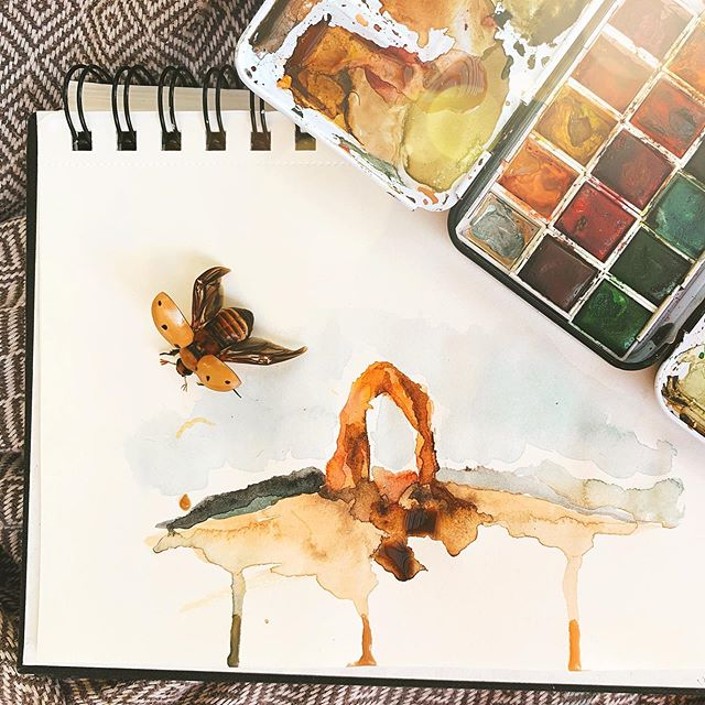 This week's blog post is all about Arches National Park in Moab, Utah! 🏜This watercolor painting of Delicate Arch was inspired by our trip to, and love for, the American Southwest. ❤️🌵😎 Also, check out the photo-bombing beetle! Love his coloring - don't you? . . Follow Earthtones Travel+Design Blog for more travel inspired illustrations and colorful destinations (link in bio)☝🏼 . . .  #southwestrocks #southwest #redrocks #rockylandscape #rockylandscapes #diverselandscape #travelideas #travelamerica #roadtrip #roadtripusa #exploreutah #landscapephotography #americanlandscape #traveldestination #destinationinspiration #travelinspiration #traveling #archesnationalpark #delicatearch #watercolor #travelsketchbook #watercolor_art #landscapepainting #travelsketching #sketchbook #watercolorjournal #beetle #bugs #utahunique