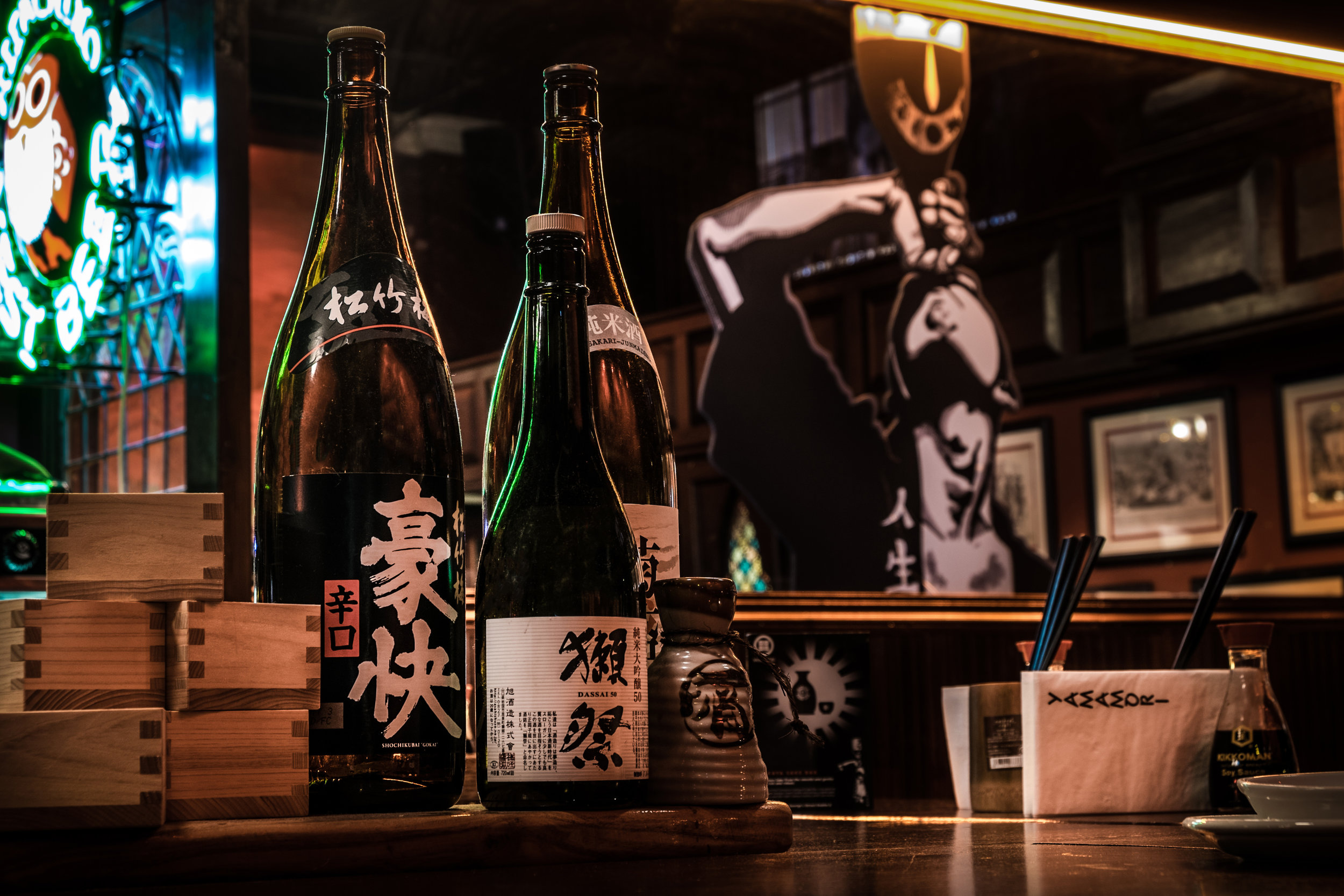 art Installations + Table tents - We commissioned an artist to install this graphic on the mirror and designed table tents with information about sake and how it's produced