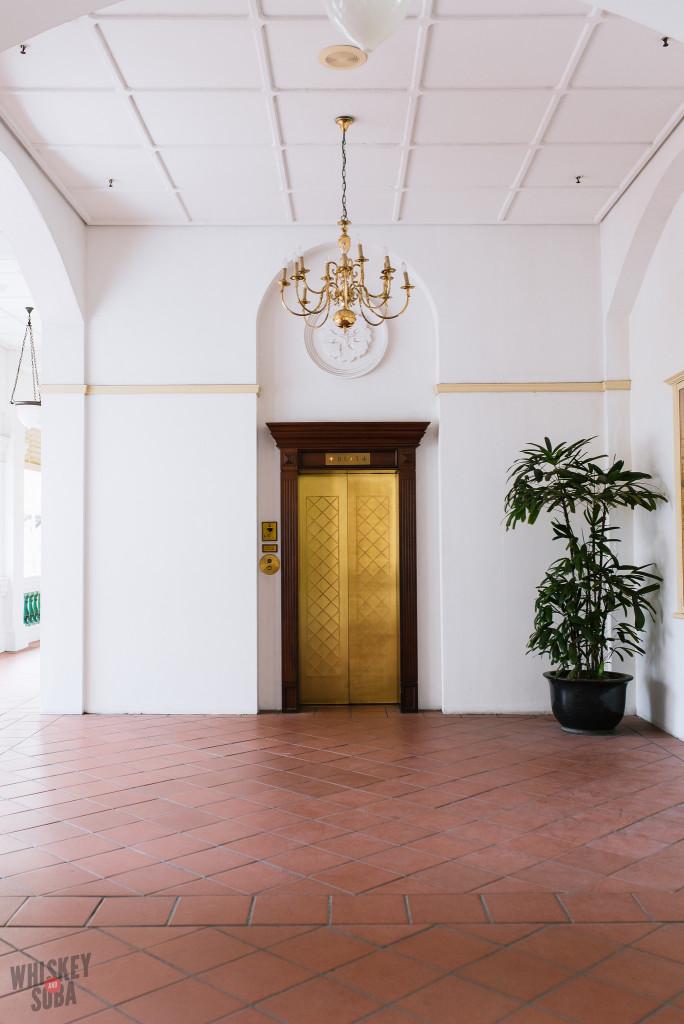 Gold Elevator at The Raffles Hotel Singapore