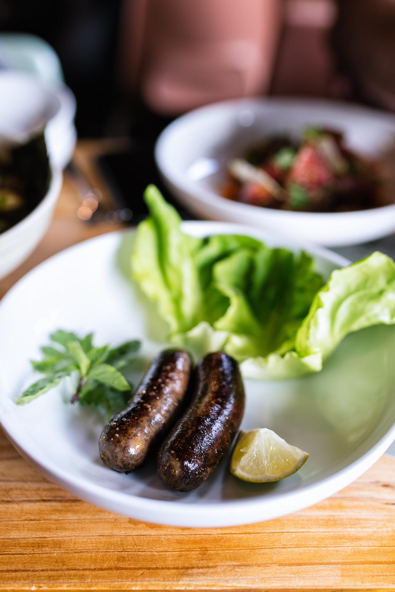 Thai sausage - lettuce, herbs, lime