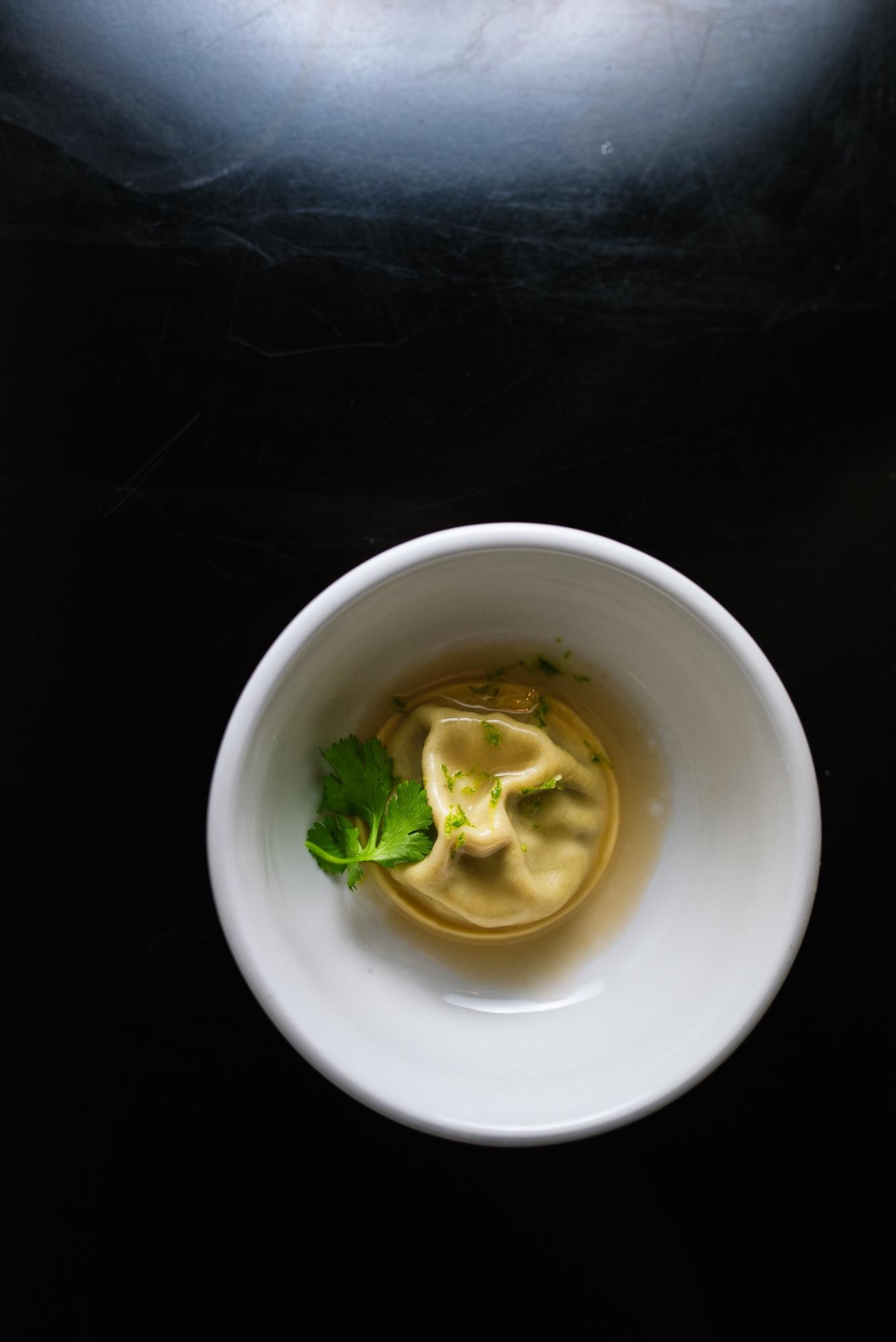 Khao Soi Soup Dumpling - curry leaf nage, cilantro, lime zest