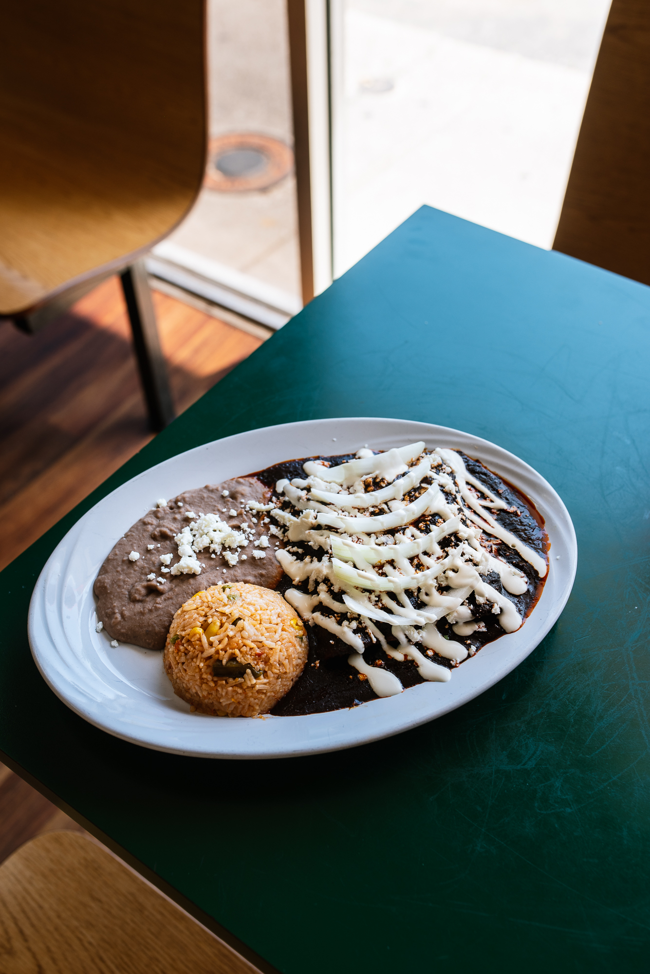mole enchiladas - Don't let the raw onion throw you off—it's there to help cut through the richness of the mole.