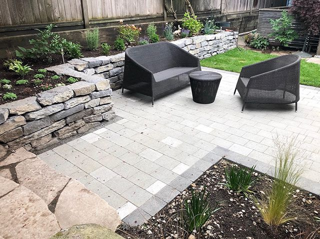 Patio Rules: kick back, read a good book, sip a drink, barbecue, appreciate the good life, gather family, entertain friends, take a long nap and relax! ☀️ ⠀⠀⠀⠀⠀⠀⠀⠀⠀ Another stunning backyard completed, just in time for the good weather! Stonework and landscaping by Sol Construction.🔨 ⠀⠀⠀⠀⠀⠀⠀⠀⠀ #solconstruction #vancouverbackyard #vancouverhomes